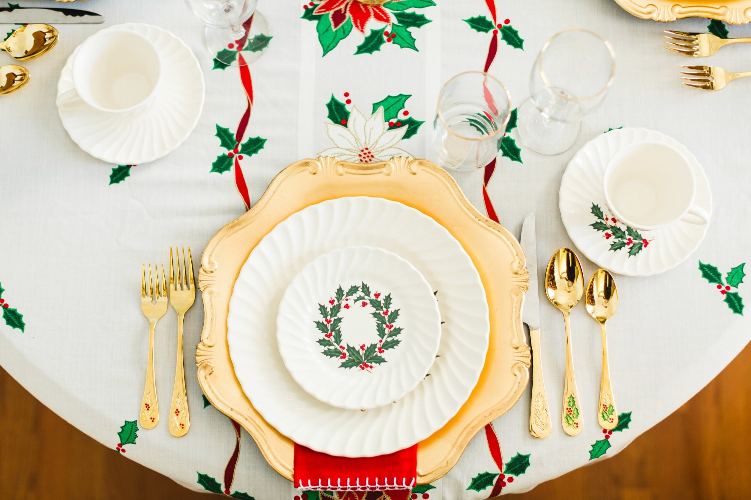Some of the color in the holly has come off the flatware, but my photographer Sara reminded me that it was part of the charm! Everything on our table is vintage except the chargers (Michael's), the napkins (Homegoods), and the wine glasses (Dollar Tree).