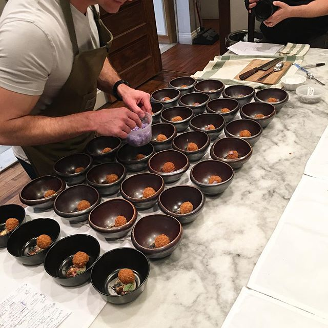 Chef @frankmcginty plating acorn croquettes// oyster mushroom pickle // fresh virginica flowers // red bud capers at chef @chefrobconnoley's second TINAR dinner
