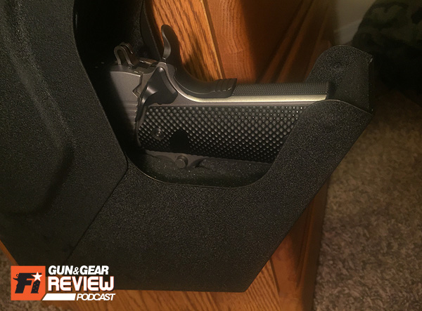 The SV-500 fits the entire full-size 1911 with no issue, and I can get my fingers around the frame to pull out.