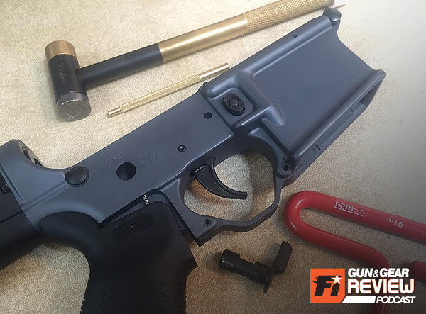 You need to remove the safety selector to properly install the trigger, so just loosen the pistol grip enough to pop it out temporarily.