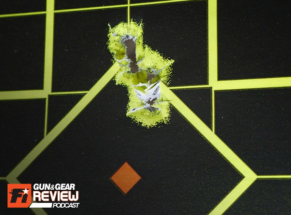 This group was shot aiming at the top of the diamond outline @ 15 yards using 115 grain FMJ ammo.