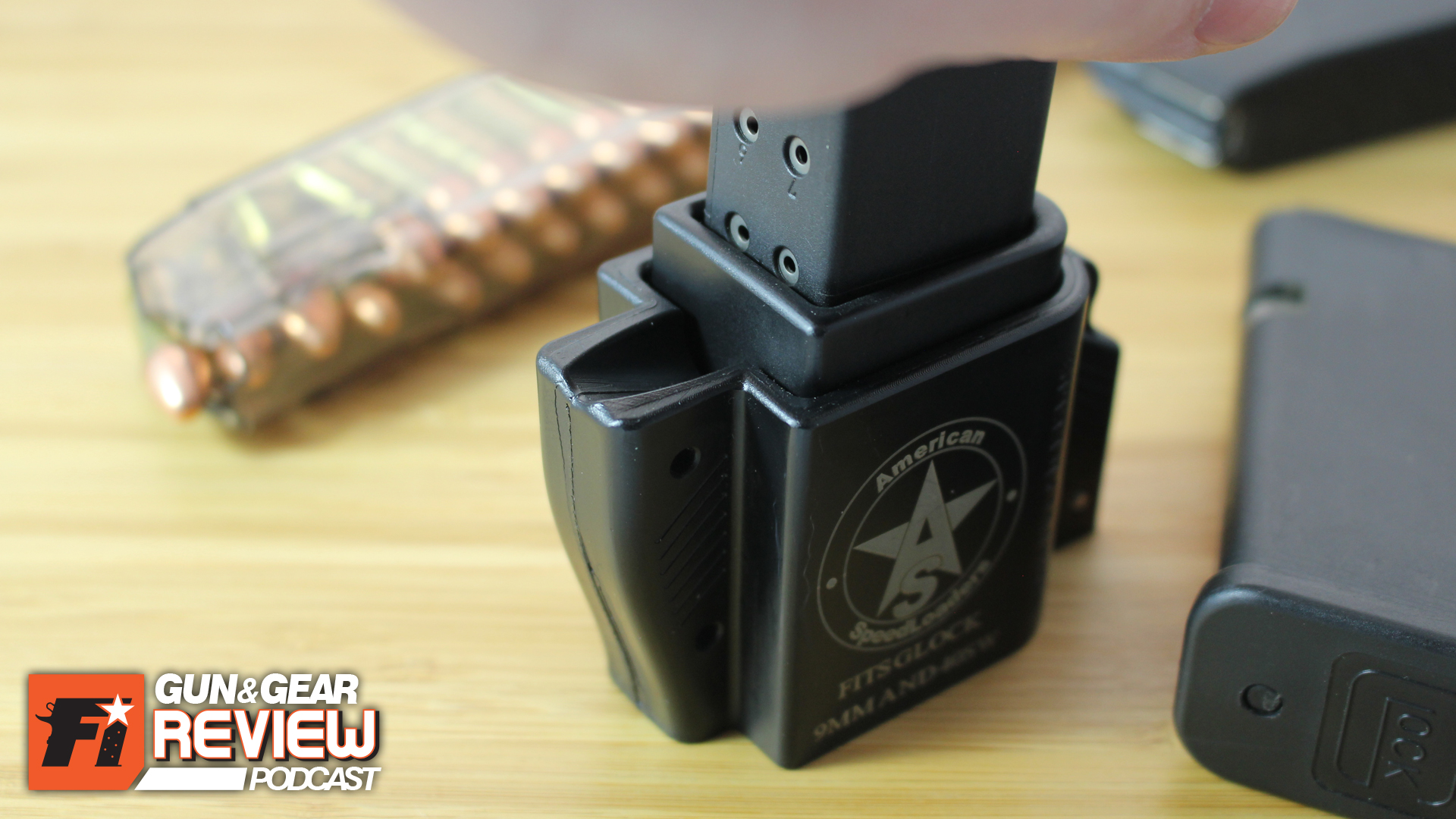 Pushing down picks up the round in the magazine. It doesn't require much force, even with the compressed spring of high capacity mags.