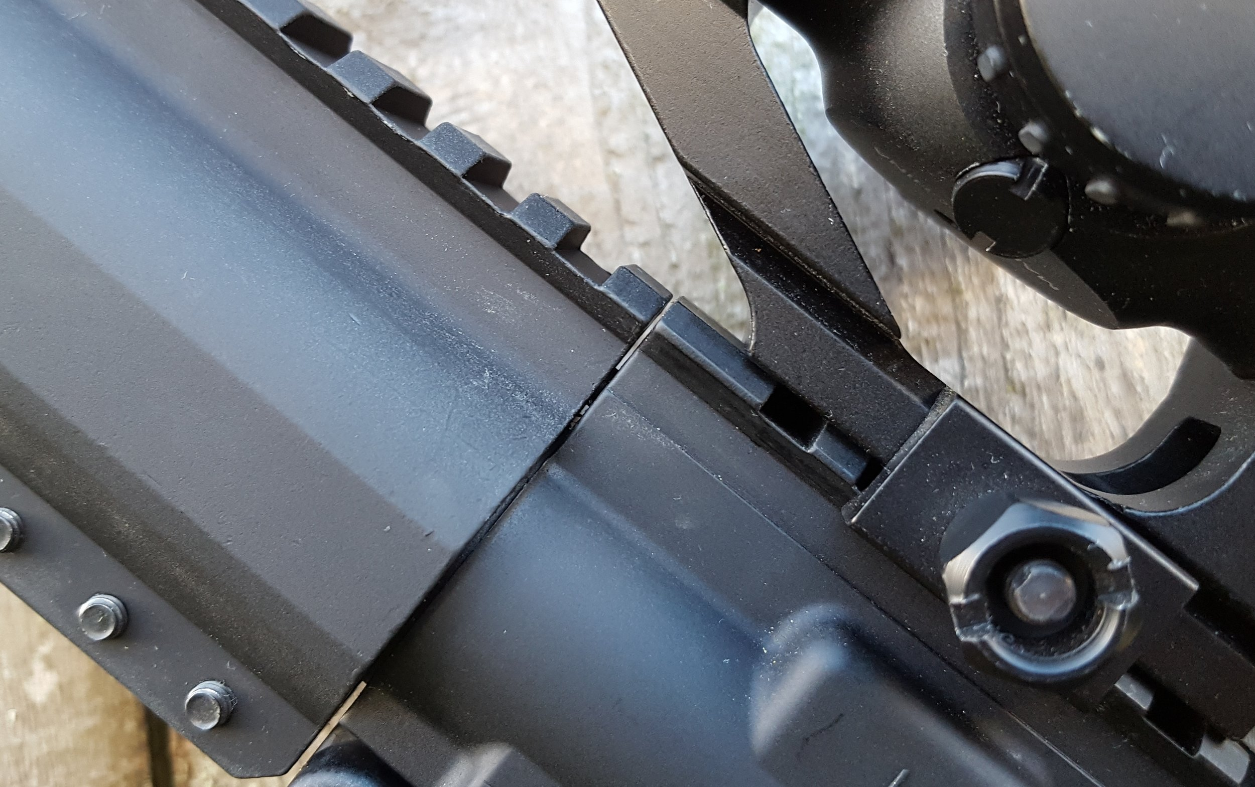 You can see the slight misalignment of the rail to the receiver