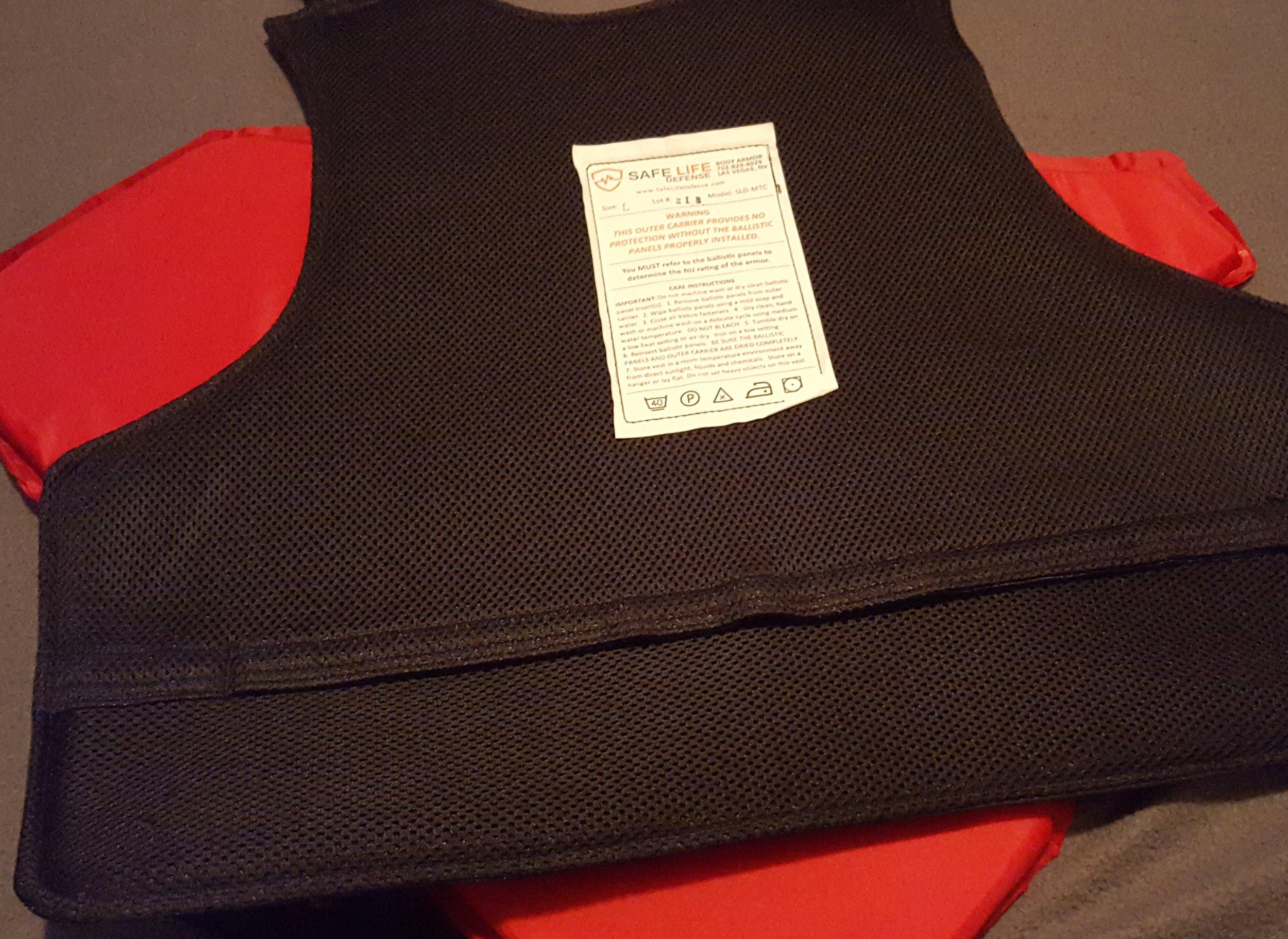Inside of vest on top of ballistic panel