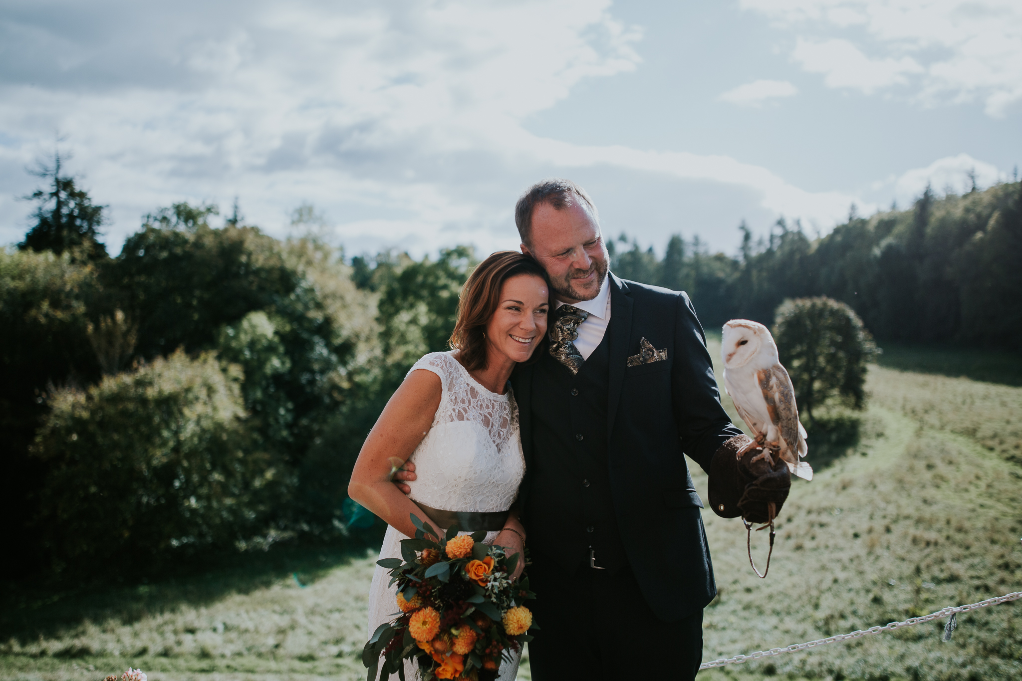 The bride and groom with the owl.