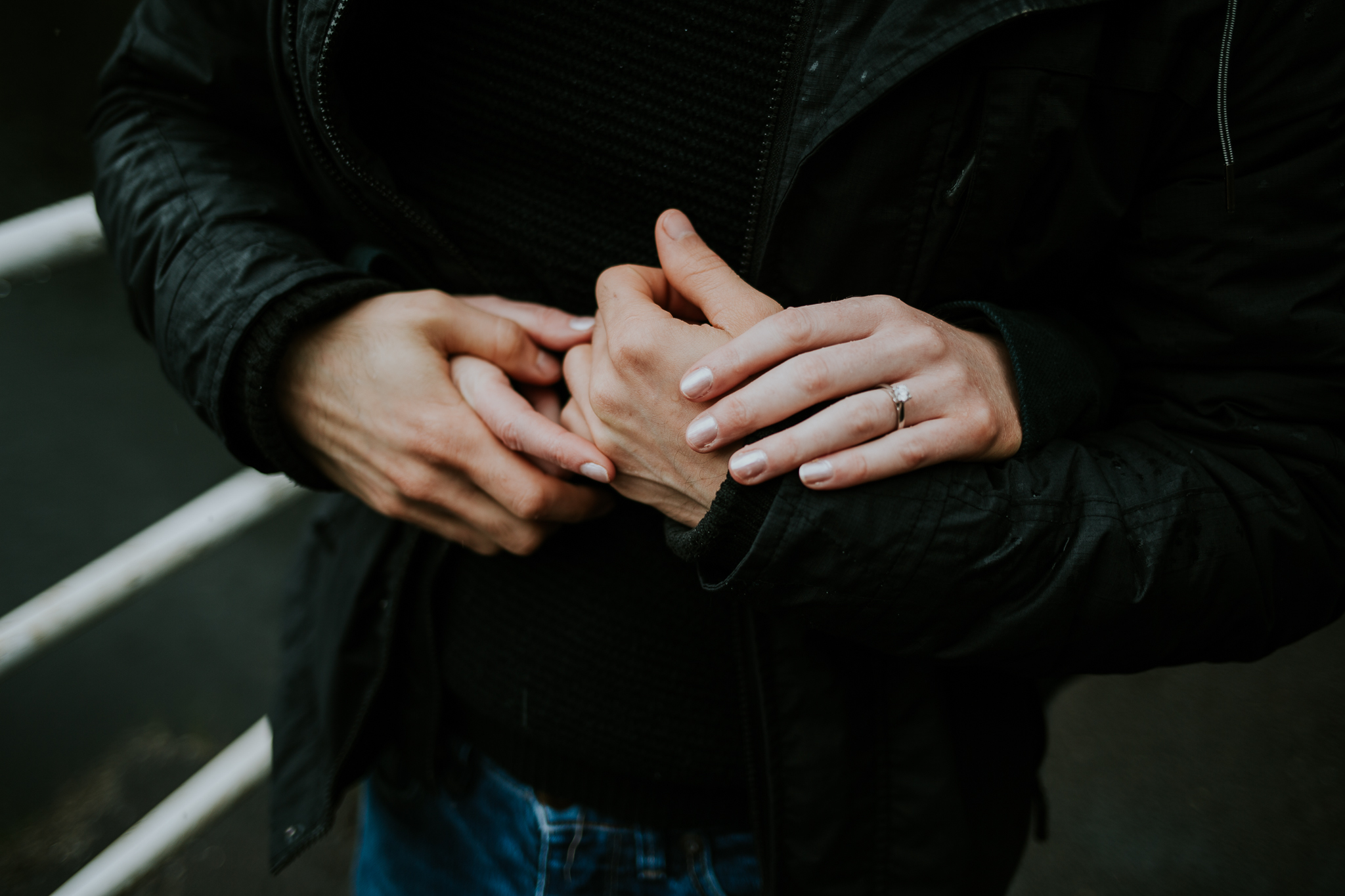 Couple are holding each other by hands in Loch Katrine, Scotland.
