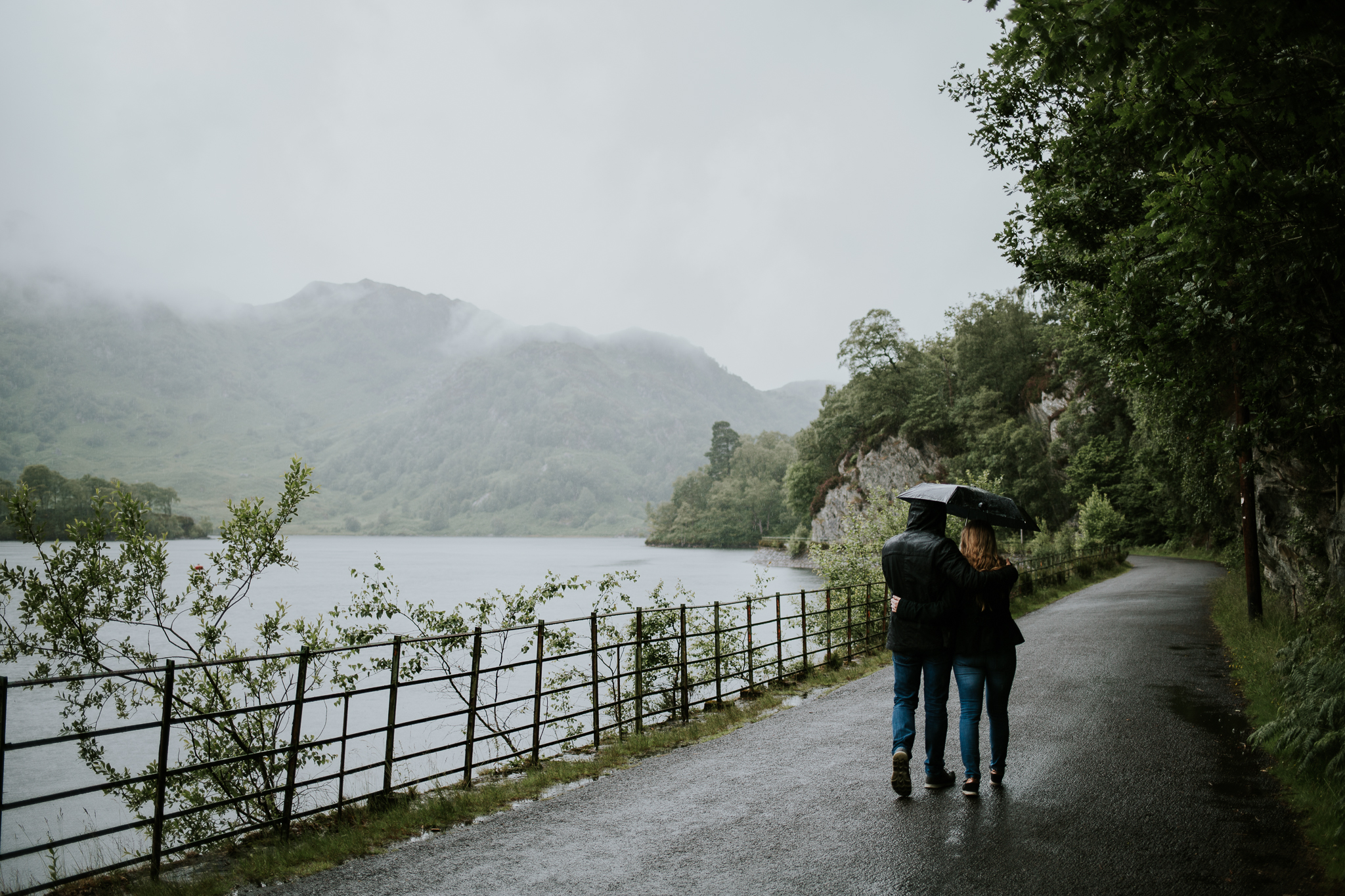 Couple is walking with embrella.