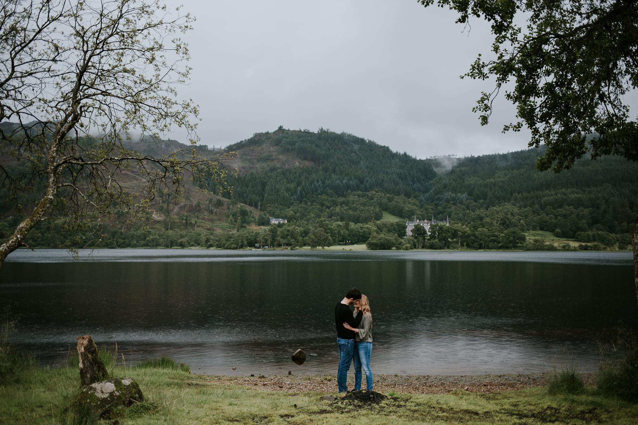 Romantic kiss under the rain.
