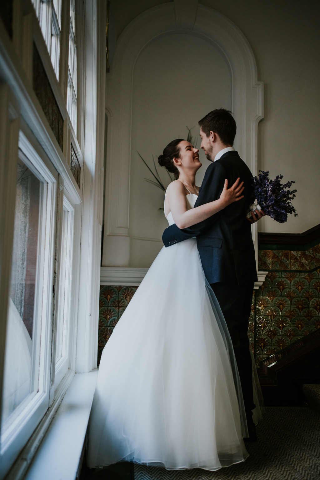 Bride and groom romantic portrait at the registry office in Glasgow