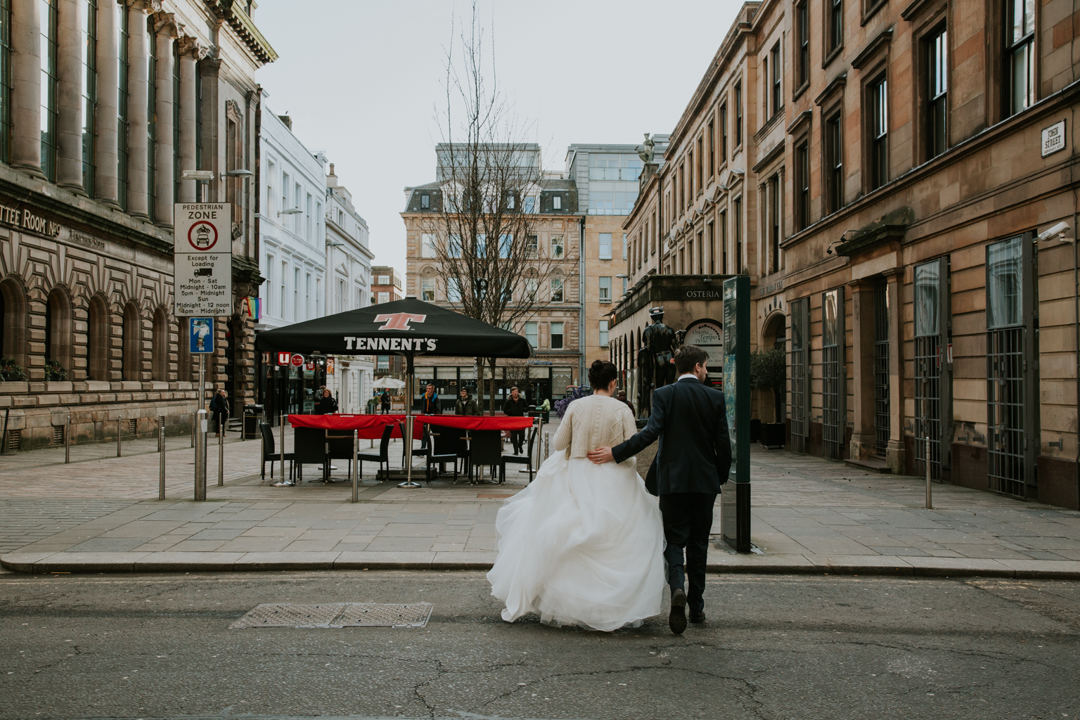 Bride and groom are passing the road to the Merchant City Glasgow
