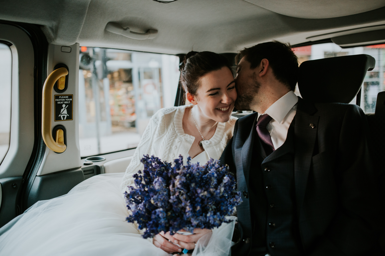Bride and groom in a taxi on the way to Brooklyn cafe in Shawlands