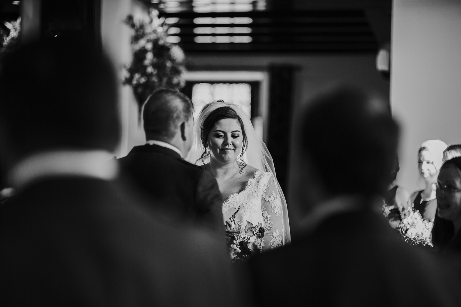 Black and white bridal portrait at the wedding ceremony