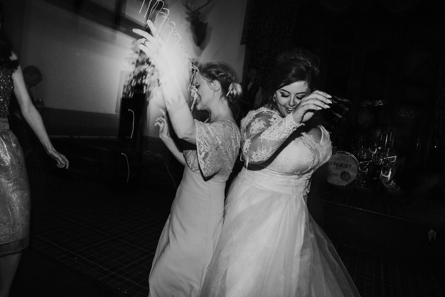 The happy bride is dancing on the floor