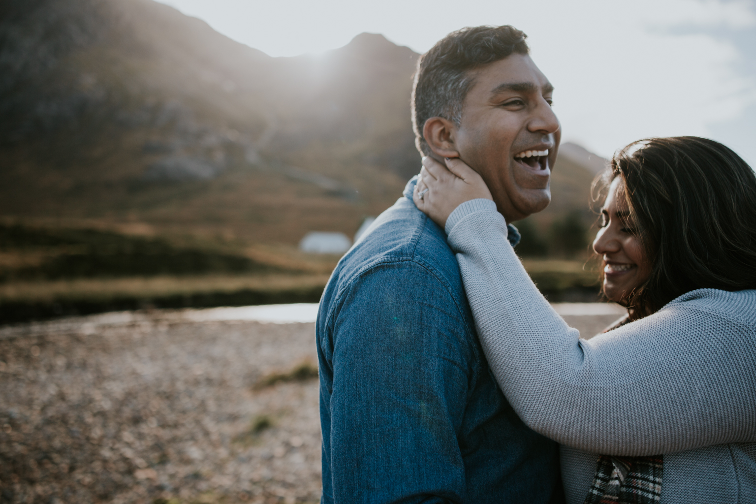 Couple is laughing in Glencoe, Scotland