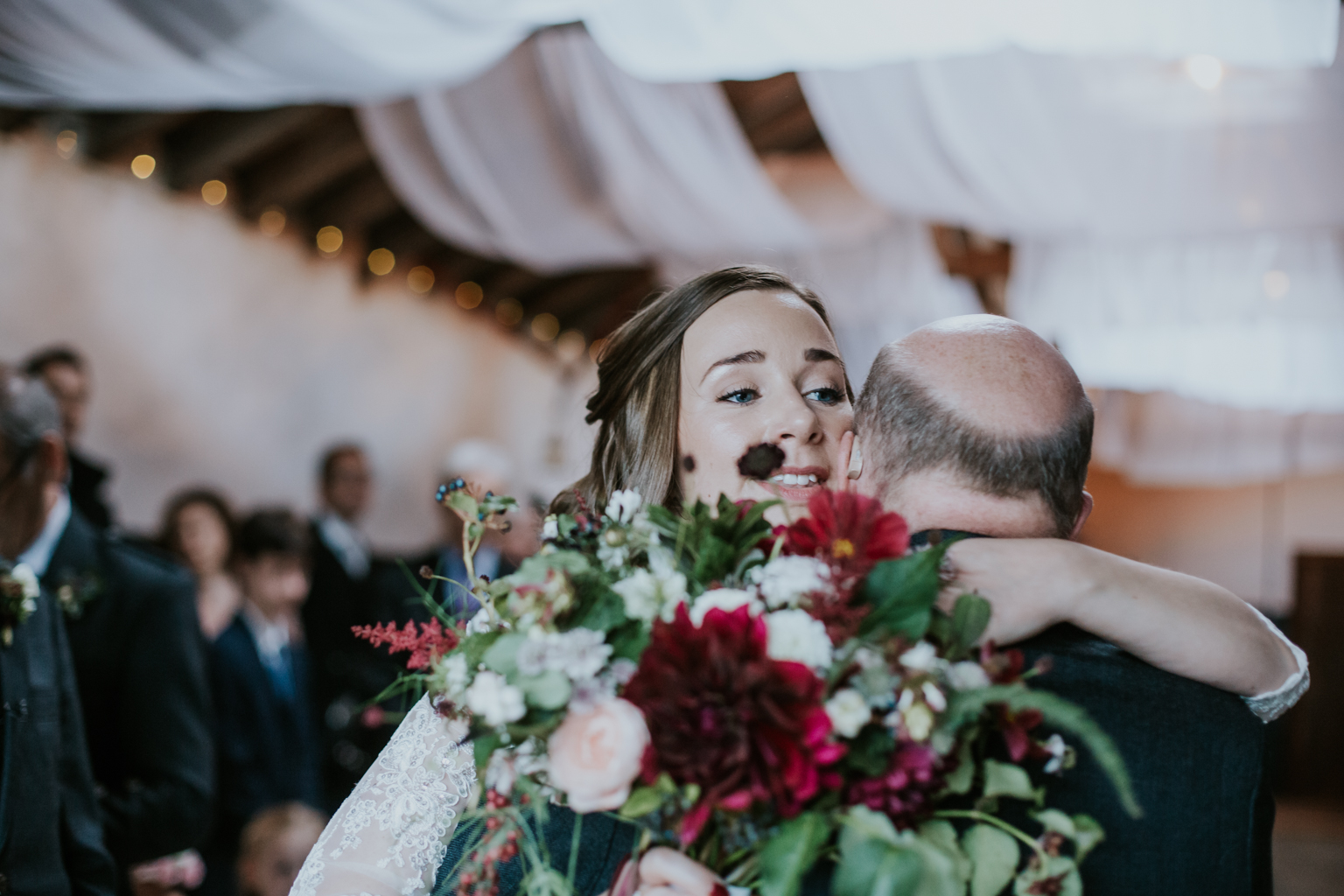 Brides gives the hug to her father