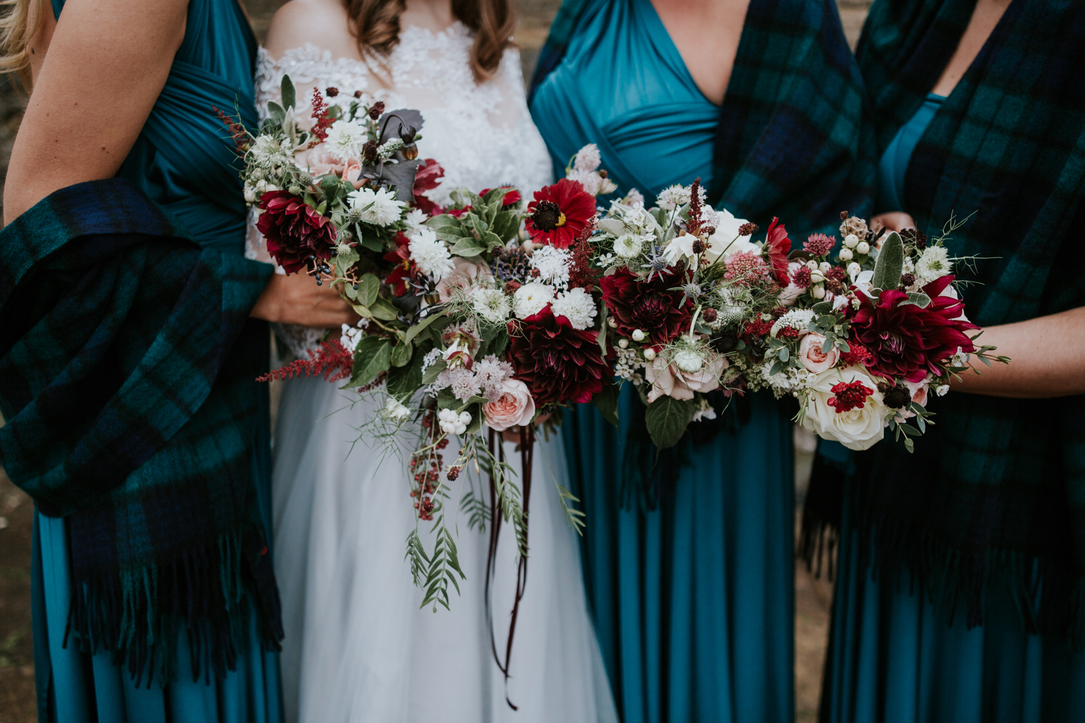 Bride and bridesmaid are holding Briar Rose Design bouquets.