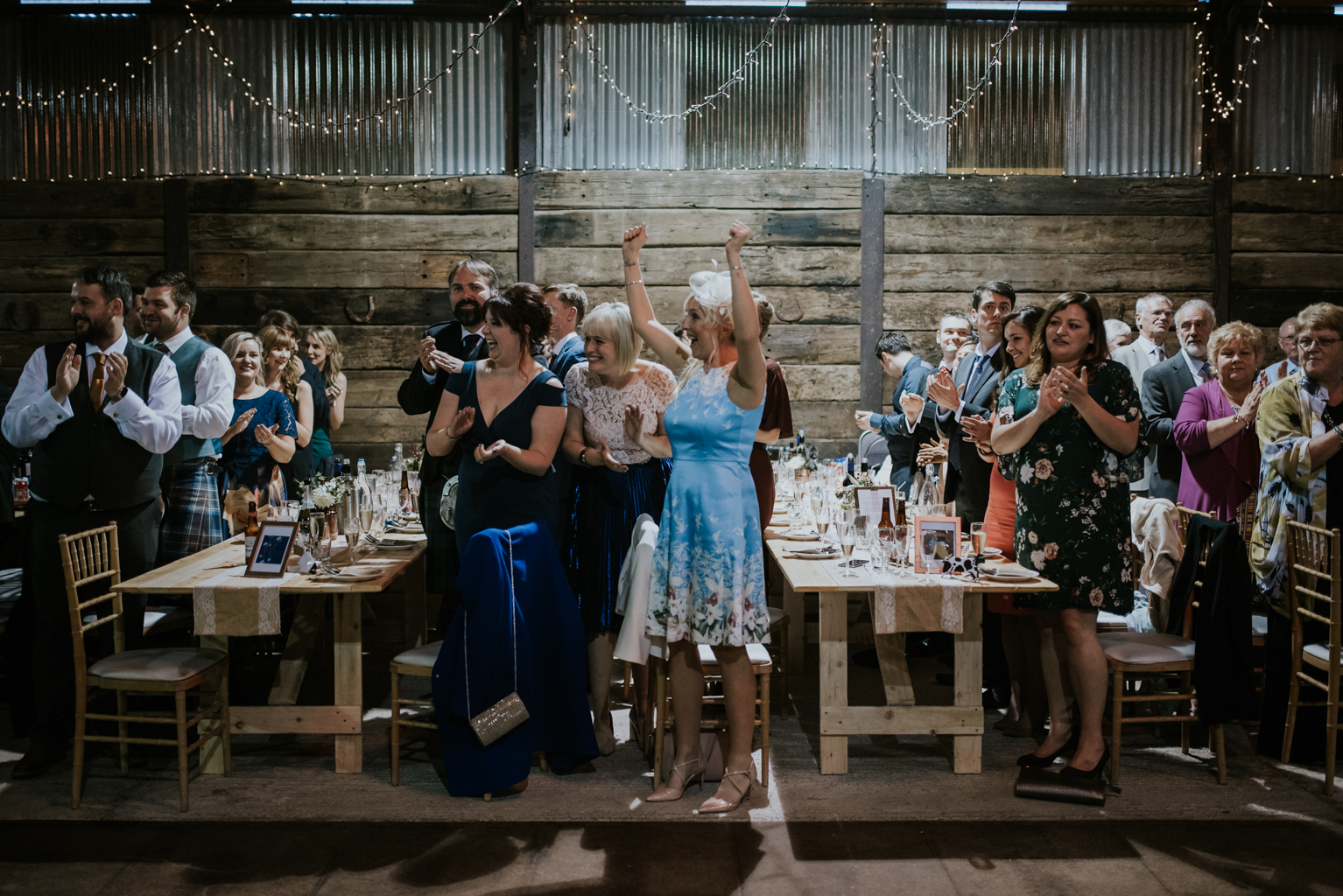 Guests are welcoming the wedding couple to the wedding reception at Harelaw farm.