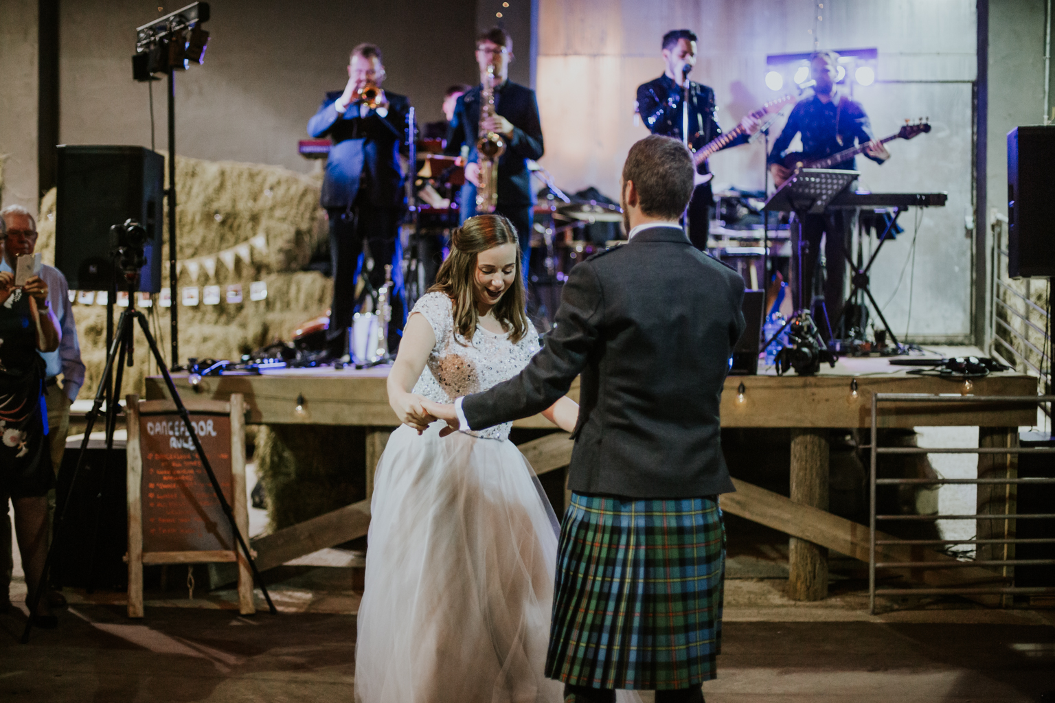 First dance as a husband and wife at Harelaw farm DIY wedding in Ayrshire. The wedding band is Nick Bruce and his Blinding Light.