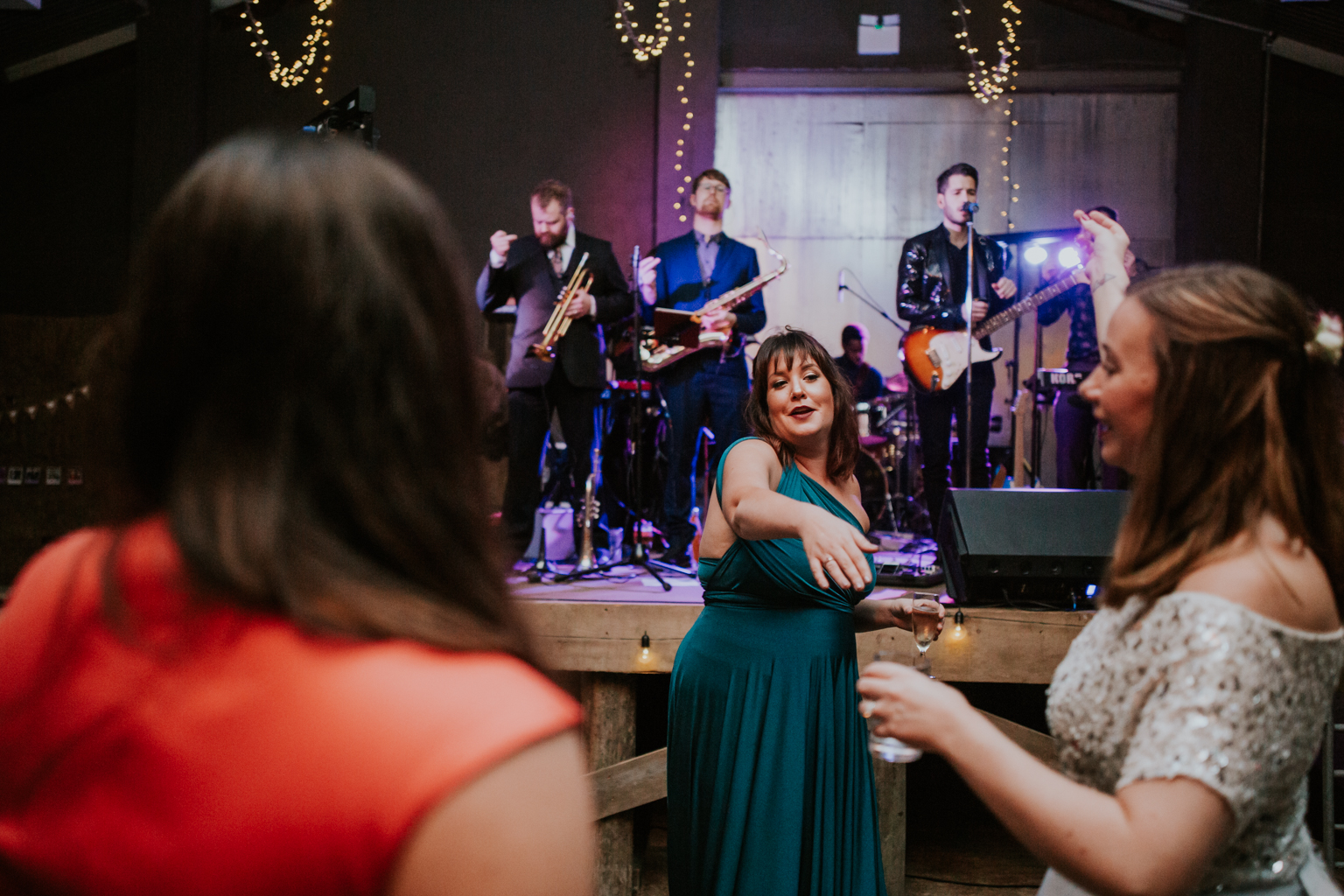 Bridesmaid is dancing with the bride at Harelaw farm wedding DIY venue.