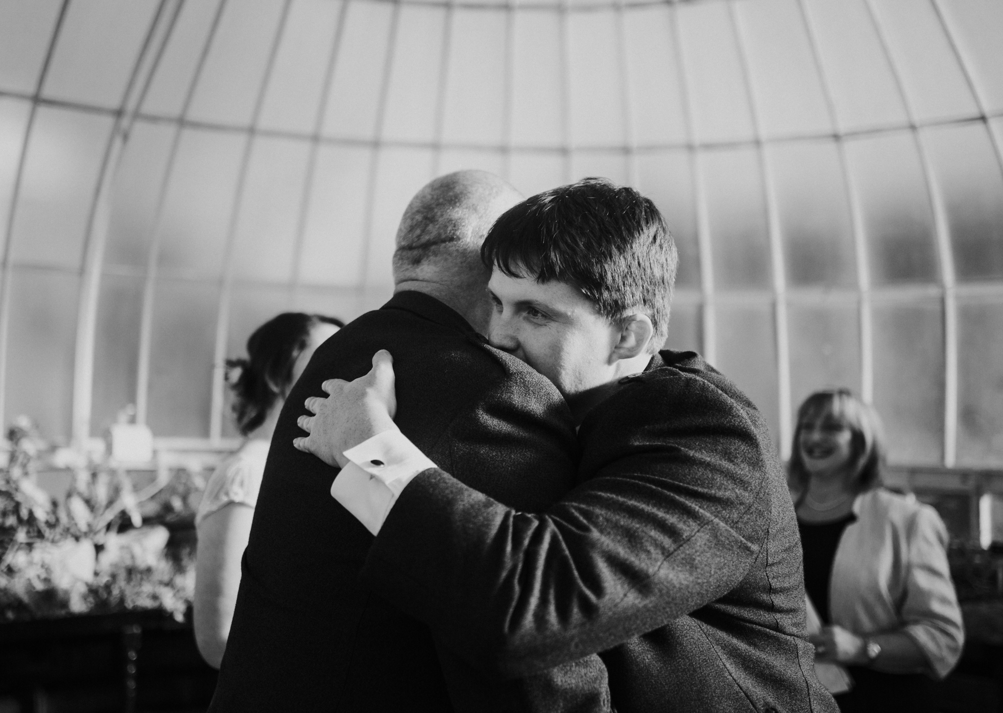 The groom and father of the bride congratulate each other
