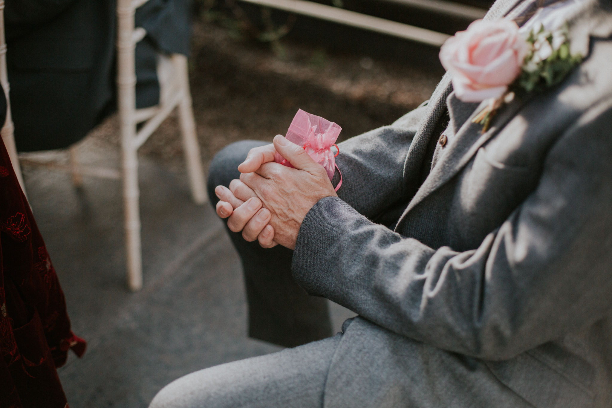 The wedding ring in the grand father's hands