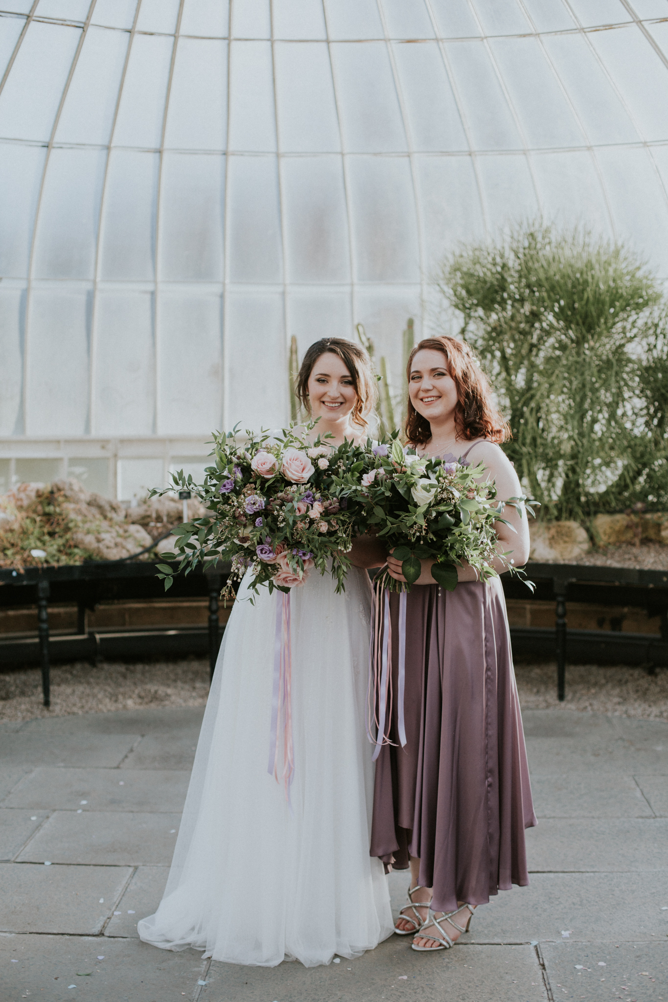 The bride and her bridesmaid's portrait at the Botanic Gardens in Glasgow