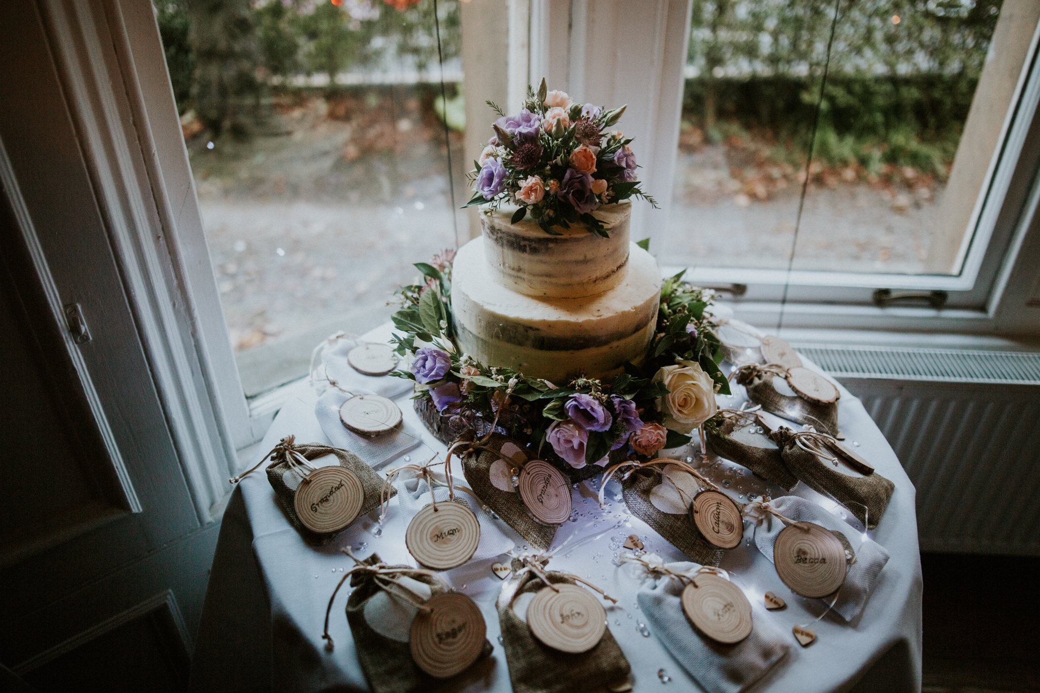 A rustic, naked wedding cake at the One Devonshire Gardens Venue