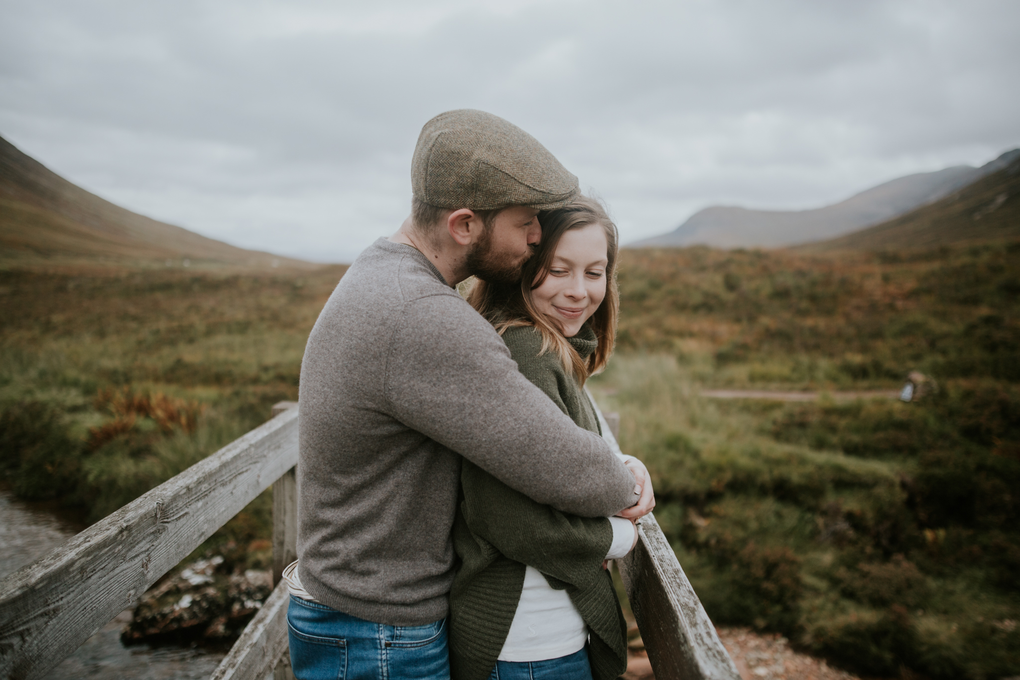 The groom is kissing the bride in the Scottish Glencoe Elopement