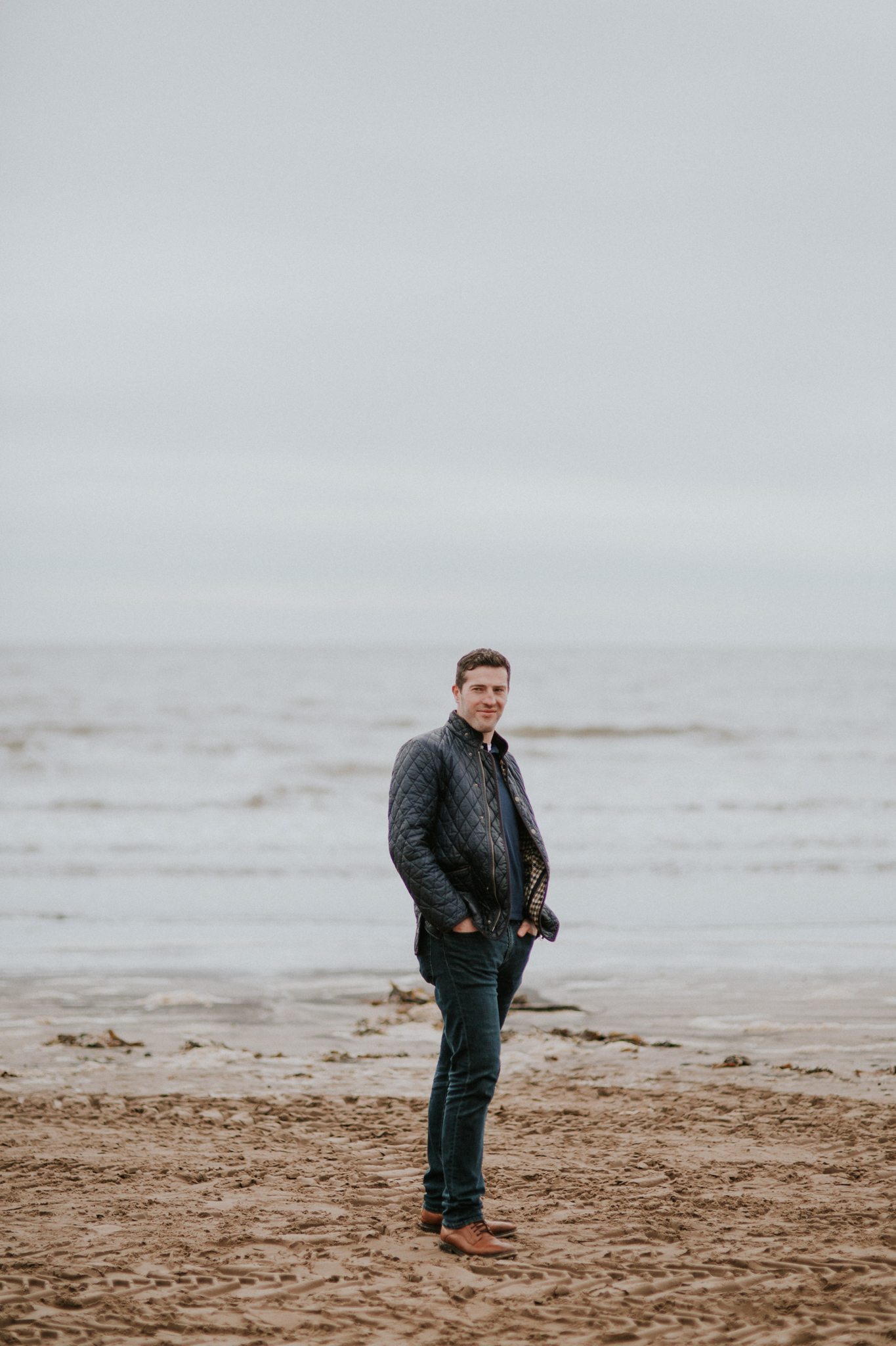 Natural portrait of the groom on the beach in Troon, Ayrshire
