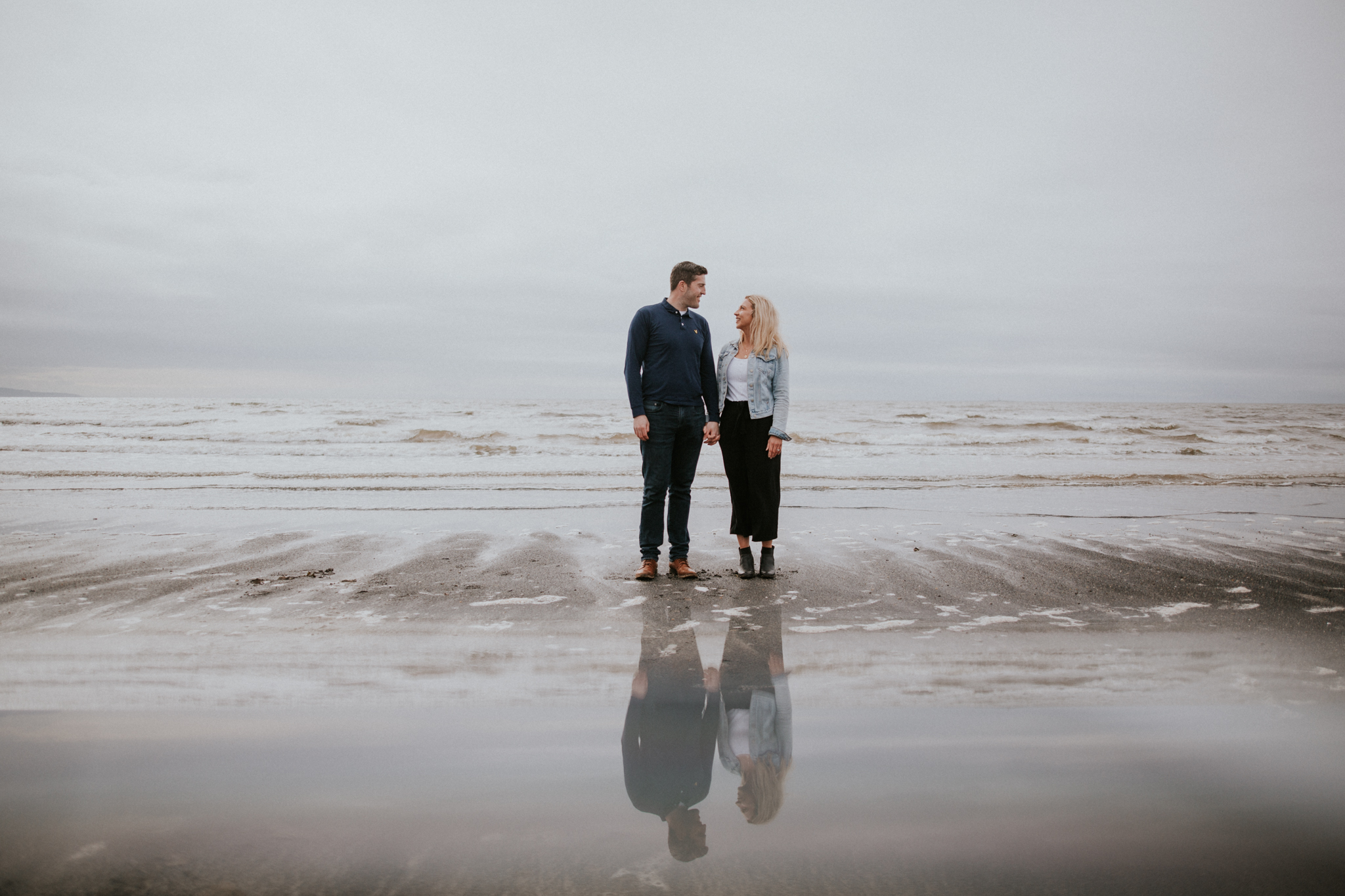 The couple's reflection on the sea in Troon, Ayrshire wedding and engagement photographer