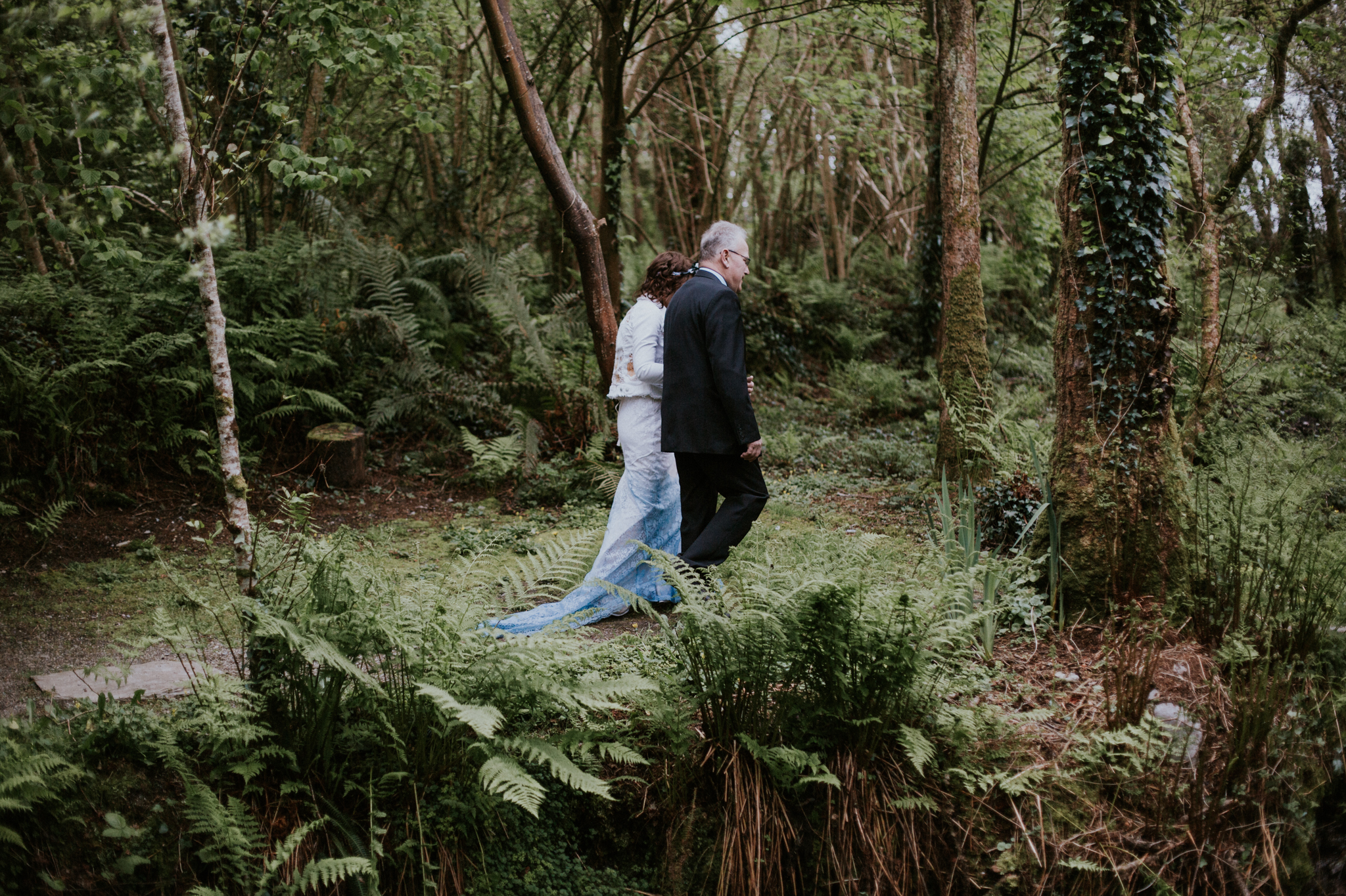 The boho bride is walking with her father to the altar at the Inish Beg Estate in Ireland