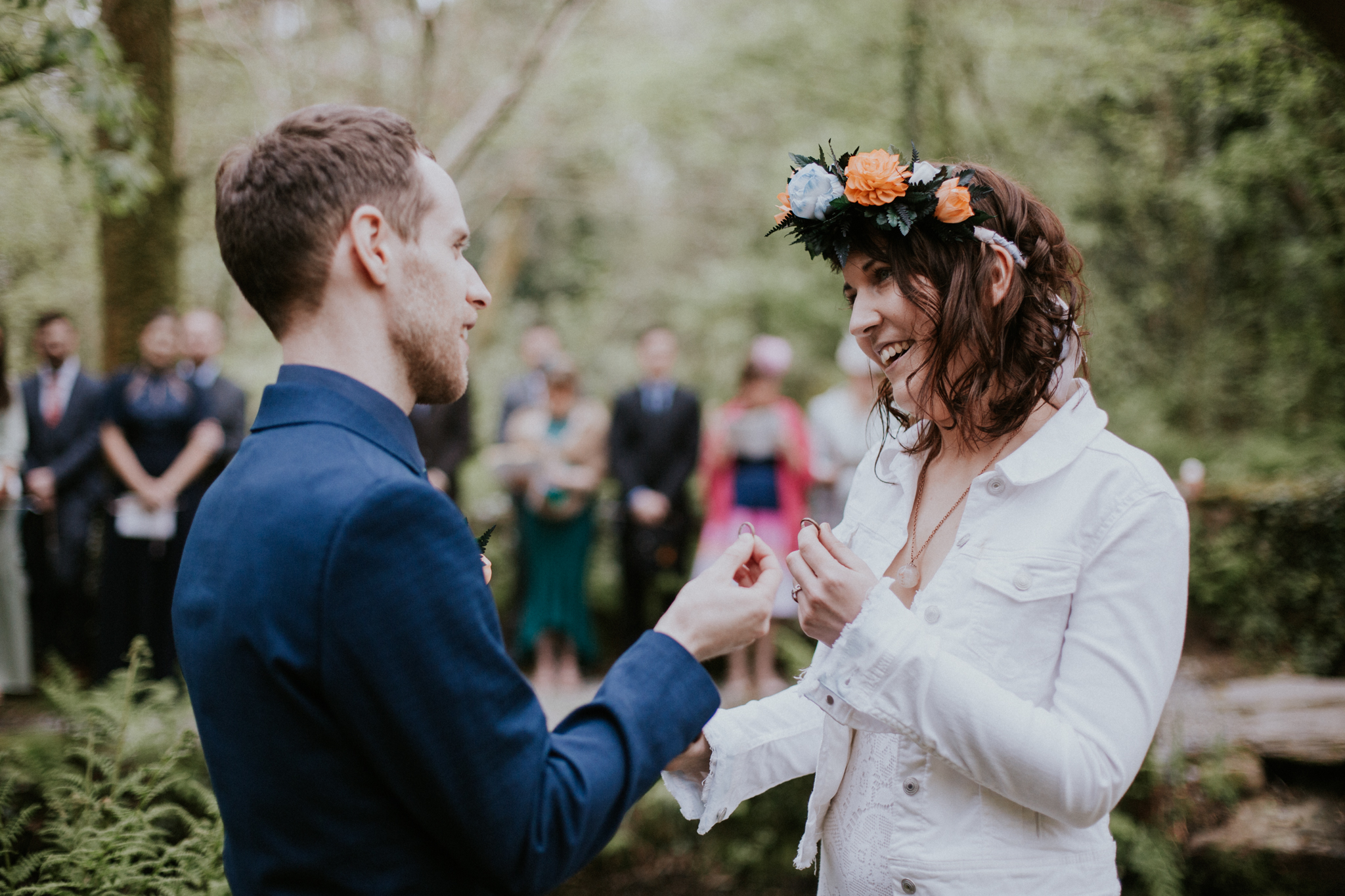 The couple is exchanging the rings at the outdoor ceremony of the Inish Beg Estate in Ireland