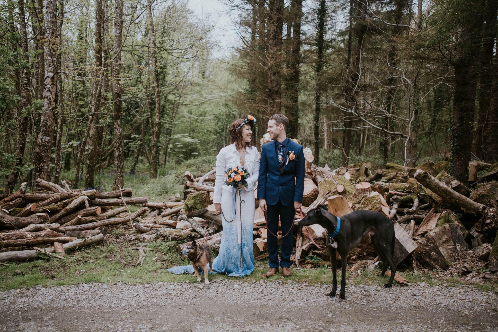 Bride and groom together with their dogs Finn and Alfi on the couple photo shoot in Inish Beg woodland