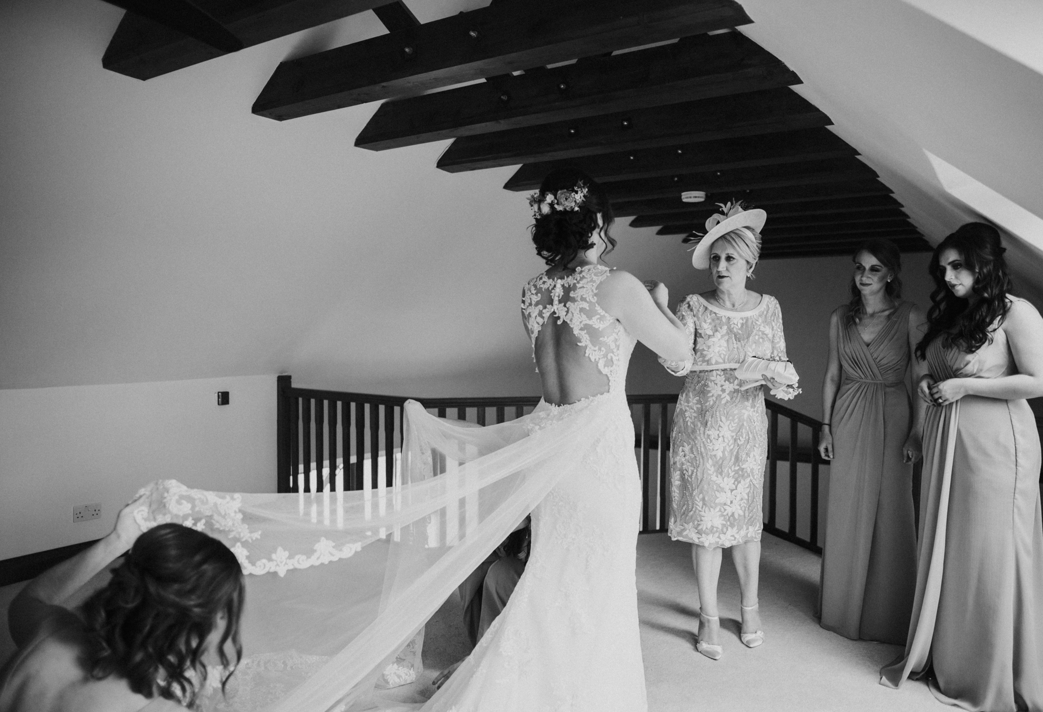 The bride with her mother and bridesmaids doing the last touches before became a wife