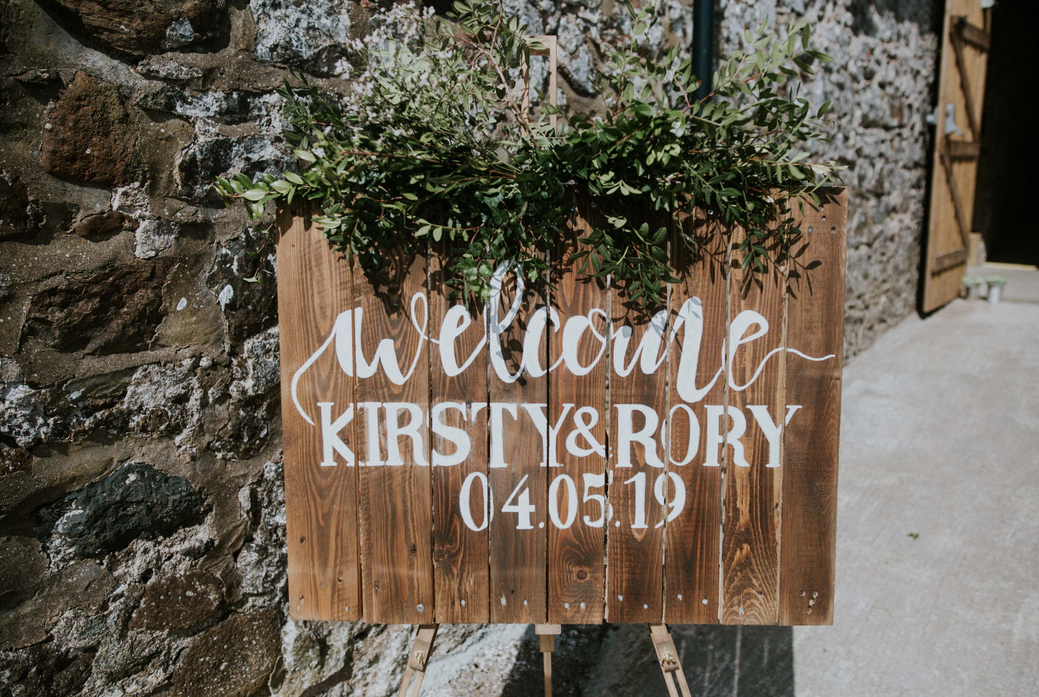 The rustic, botanical sign of Kirsty & Rory are getting married at Harelaw farm