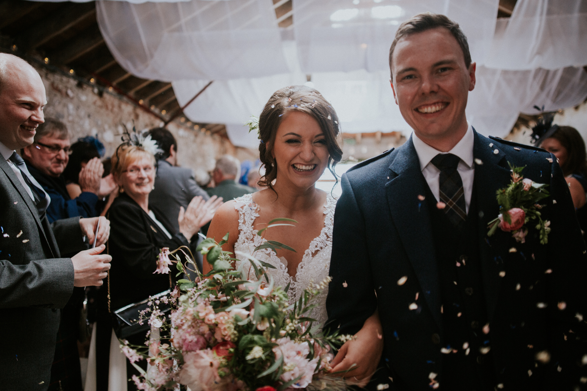The bride and groom are walking back as a husband and wife during the stunning confetti shoot