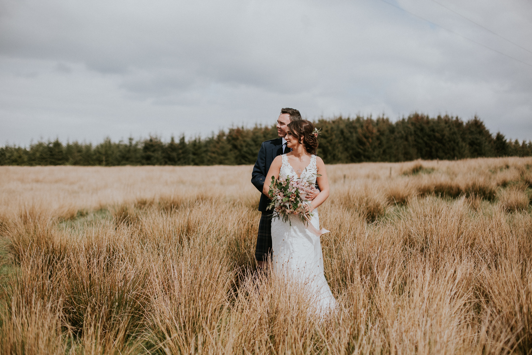 Romantic and intimate shot of the newlywed couple at Harelaw farm