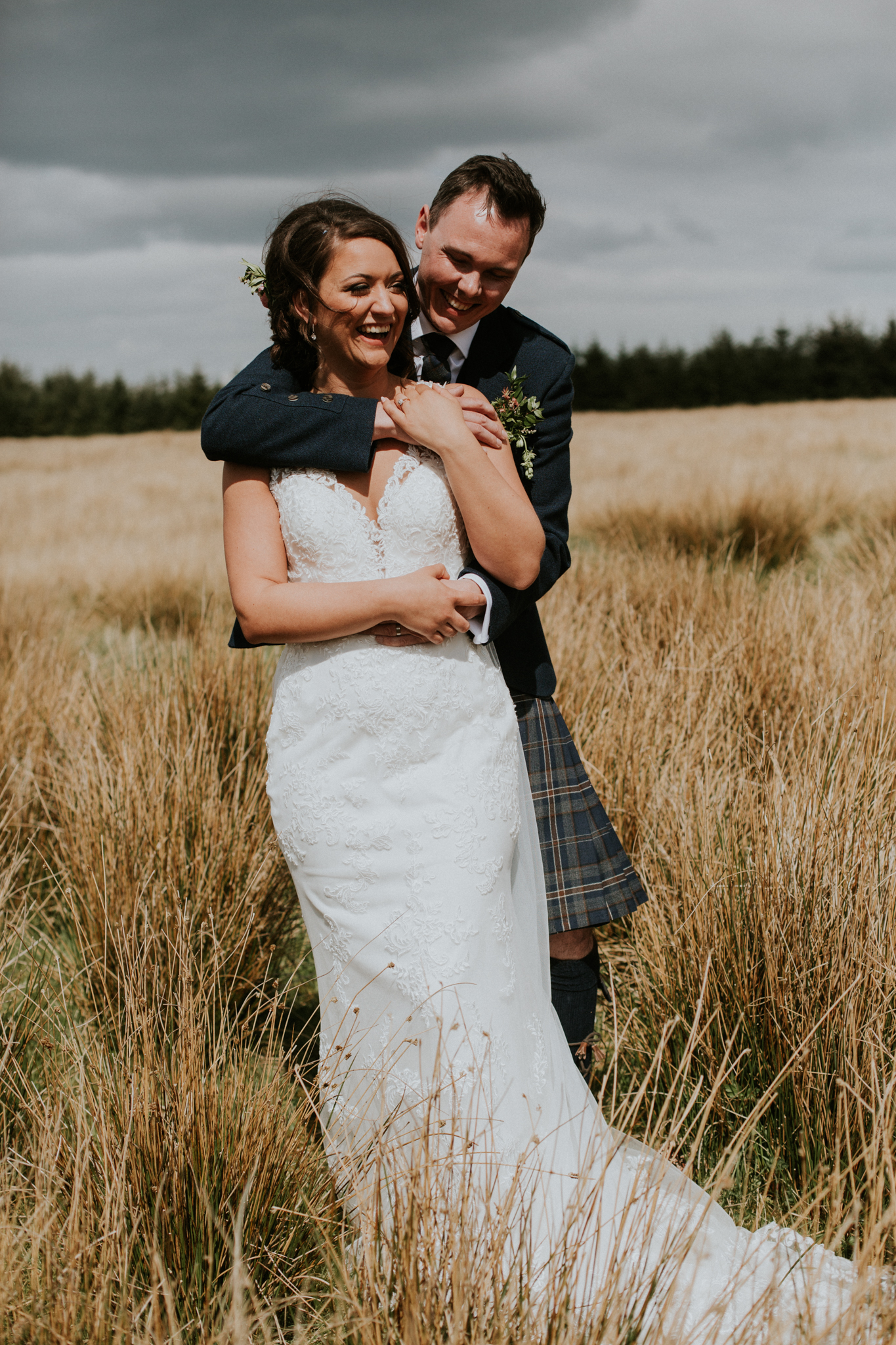 The bride and groom laughing during their couple shoot at Harelaw farm