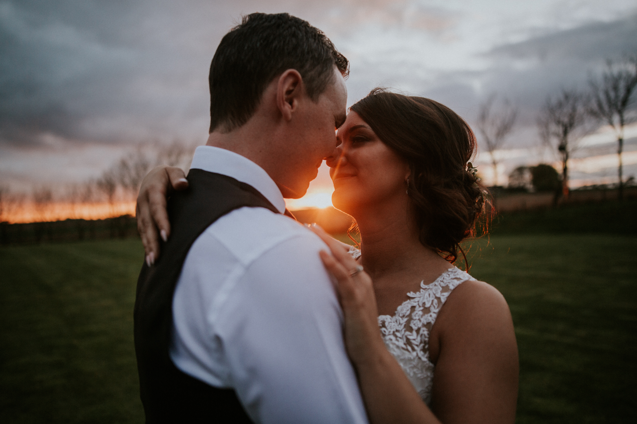 The close up kiss shot during the golden sunset at the Harelaw farm