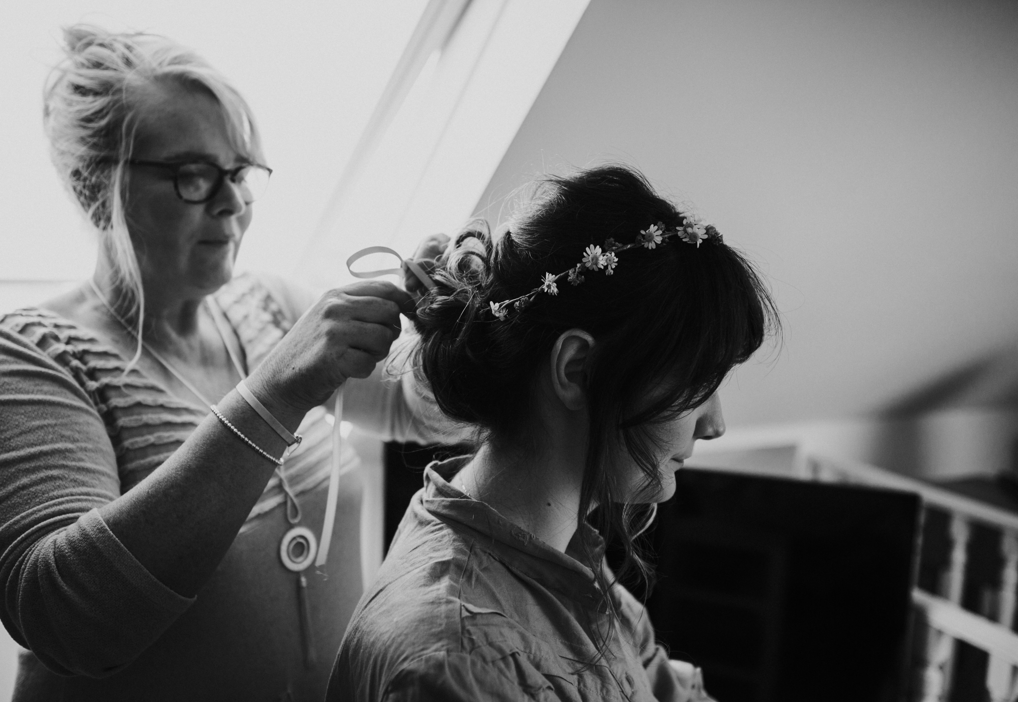 Bride is wearing a boho flower crown on her wedding day