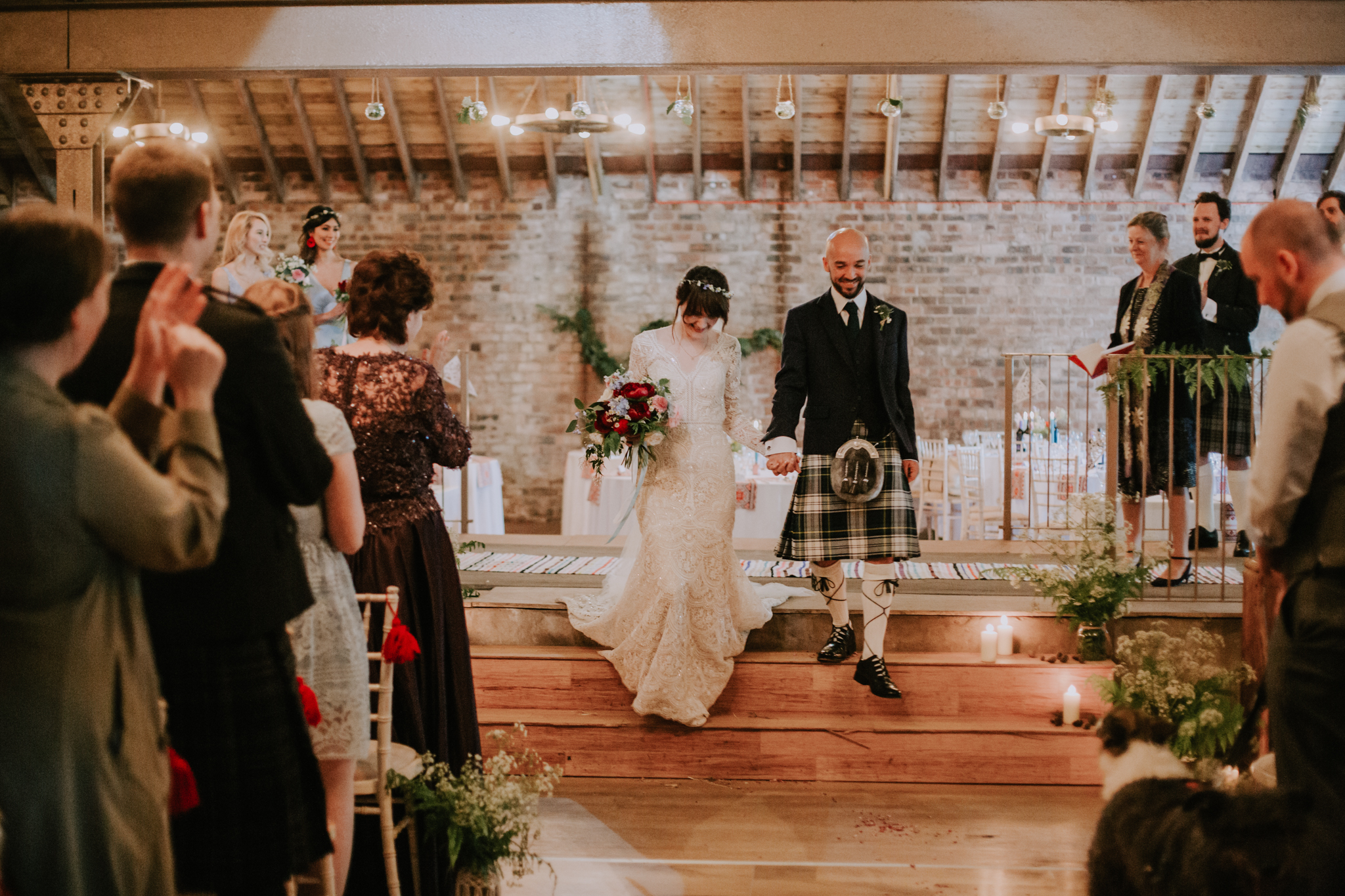The bride and groom walk down the aisle as a husband and wife