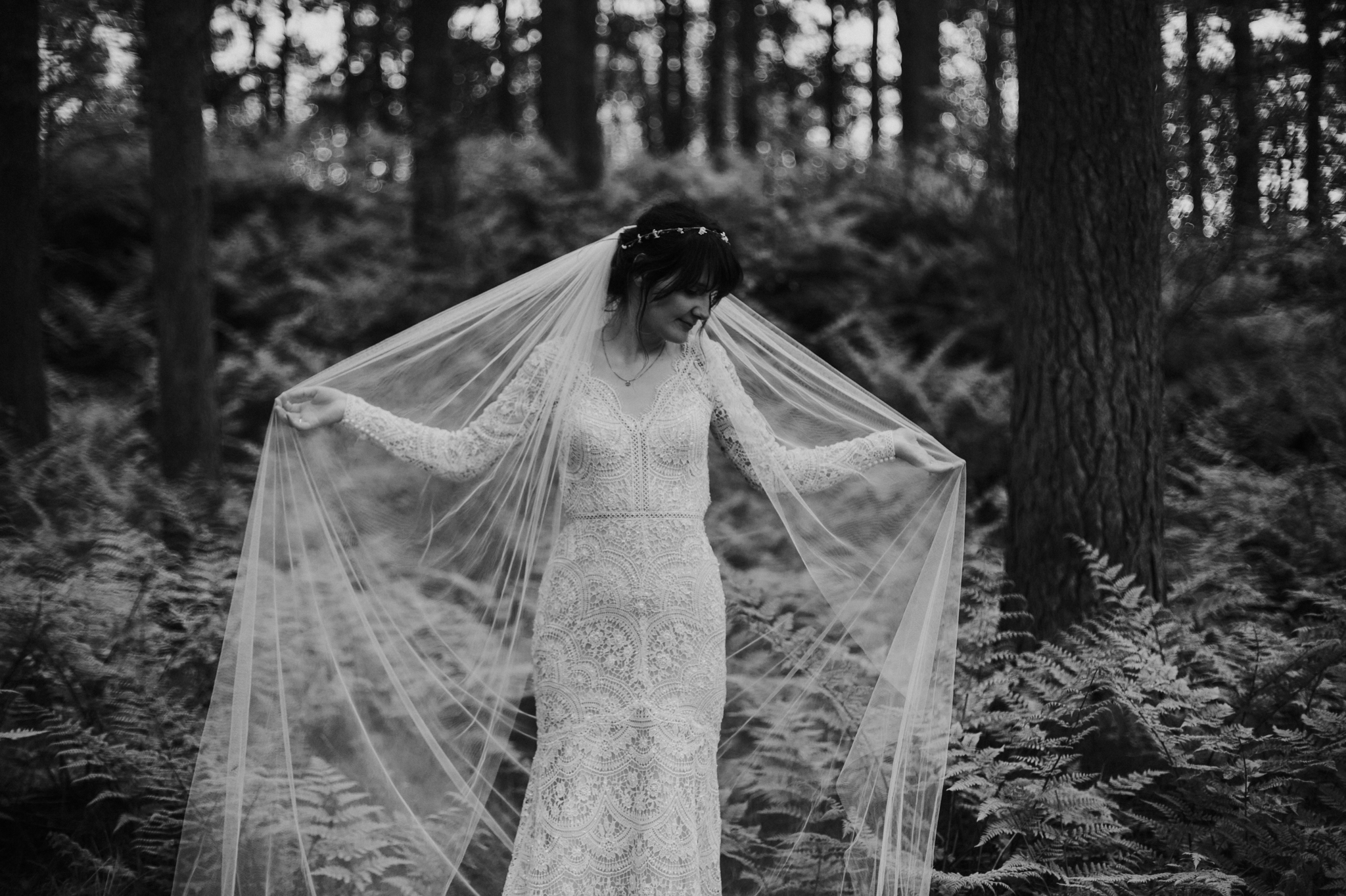 The creative shot of the bride in the wild forest