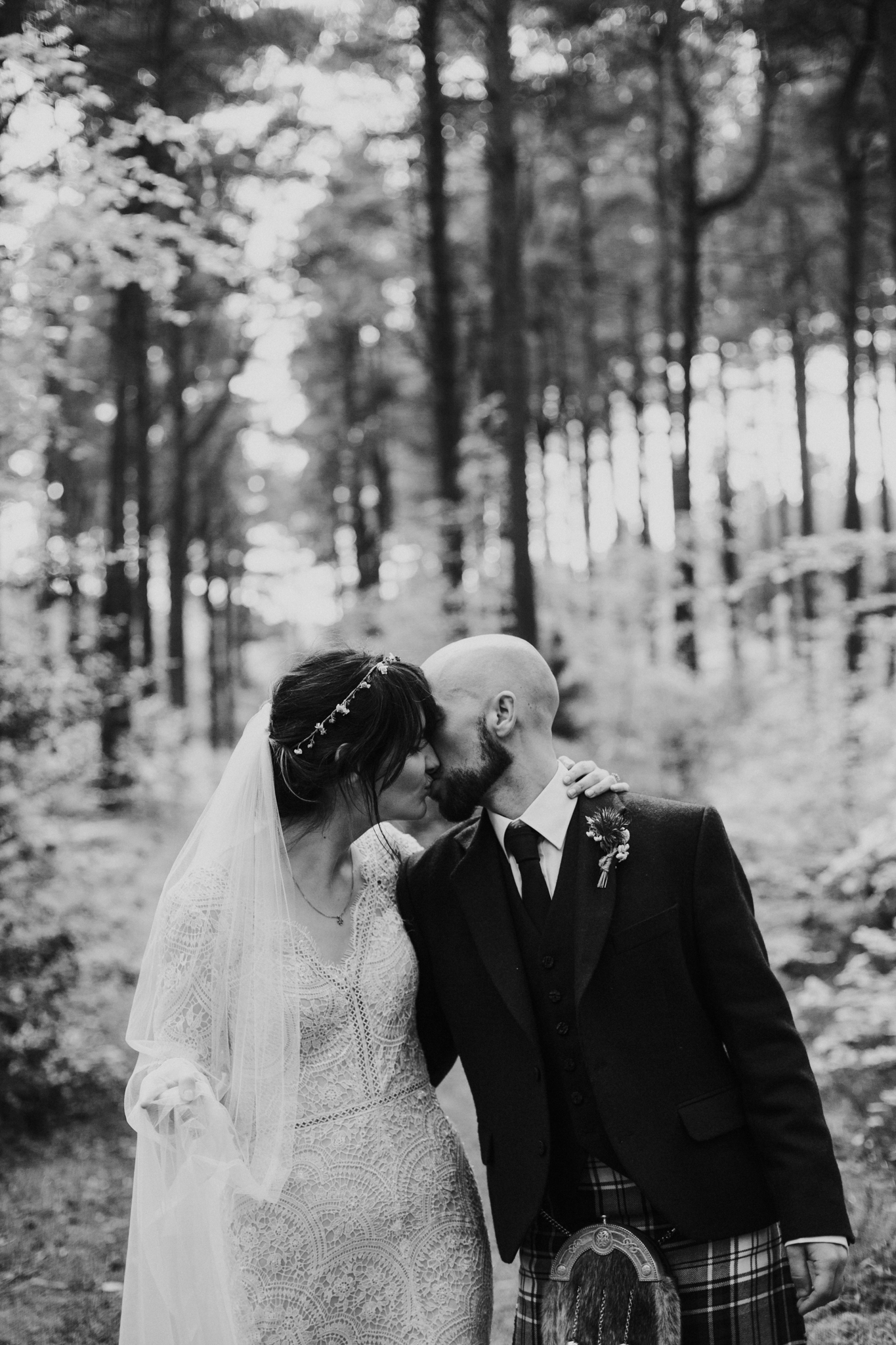 A sweet kiss while walking in the wild forest
