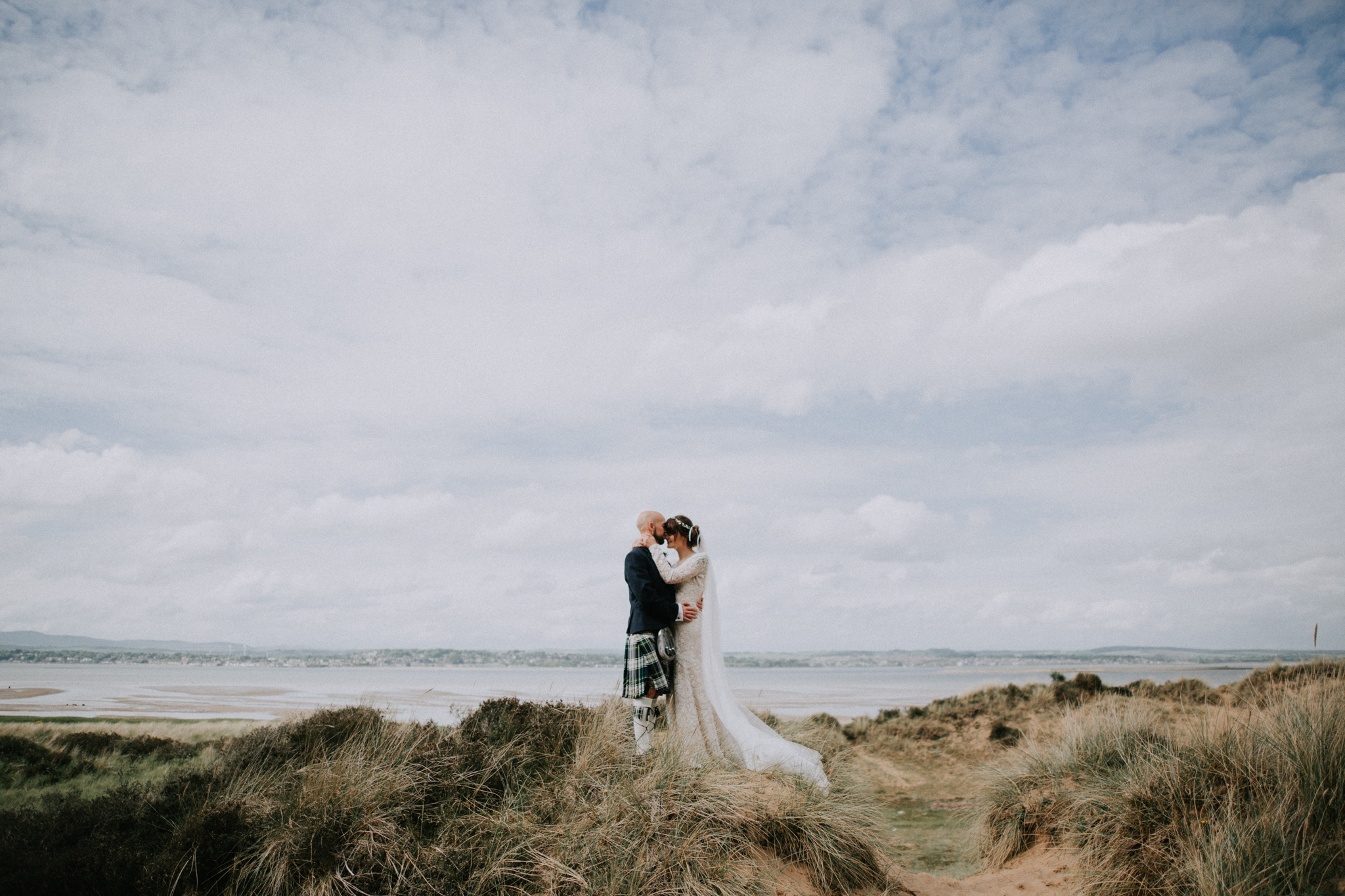 A wide angle shot of the couple on the beach