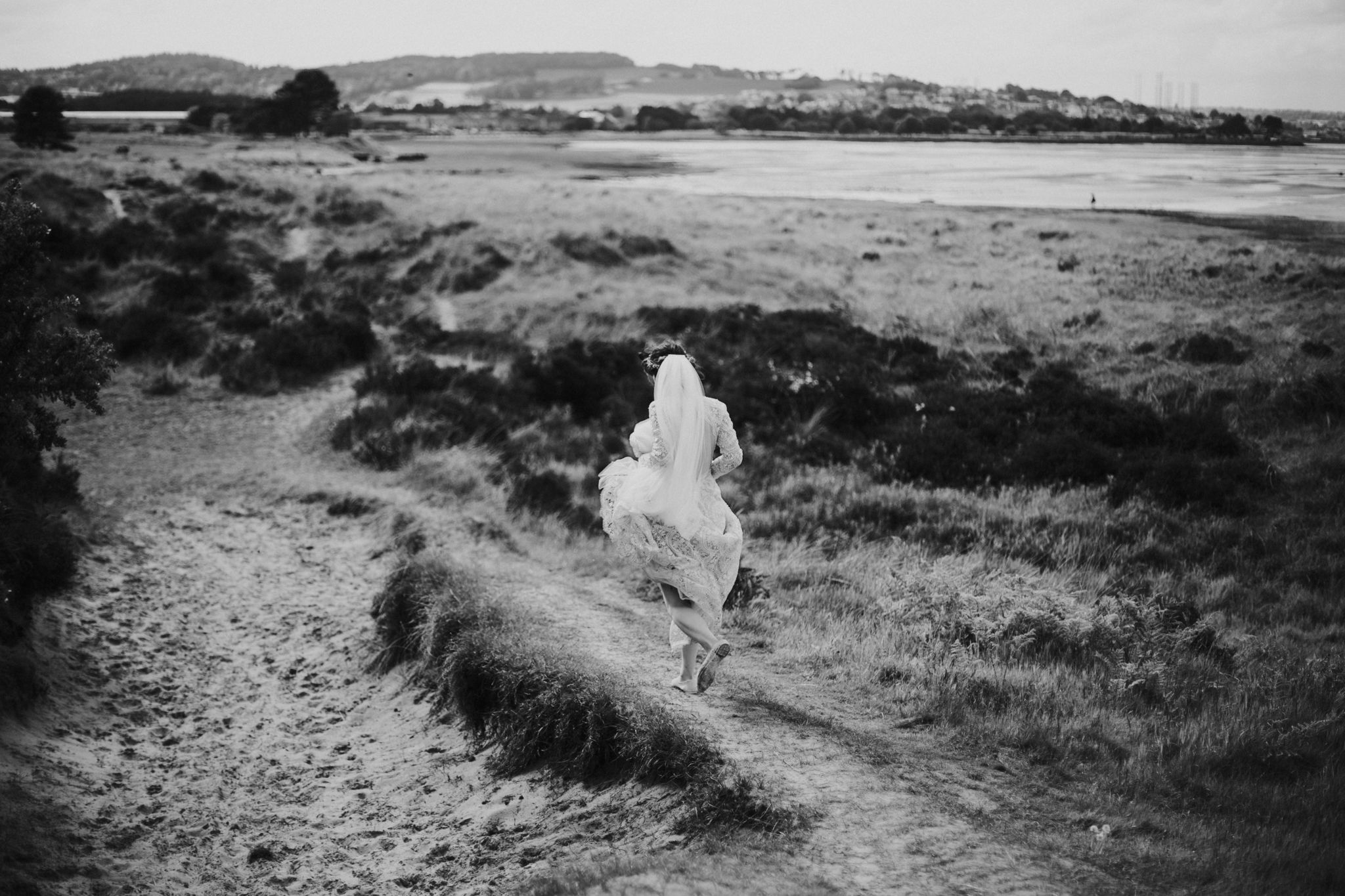 The running bride on the beach