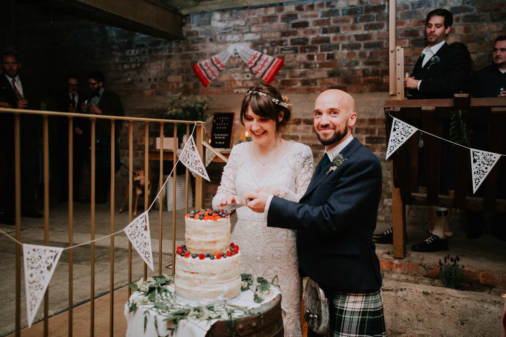 Bride and the groom are cutting the cake