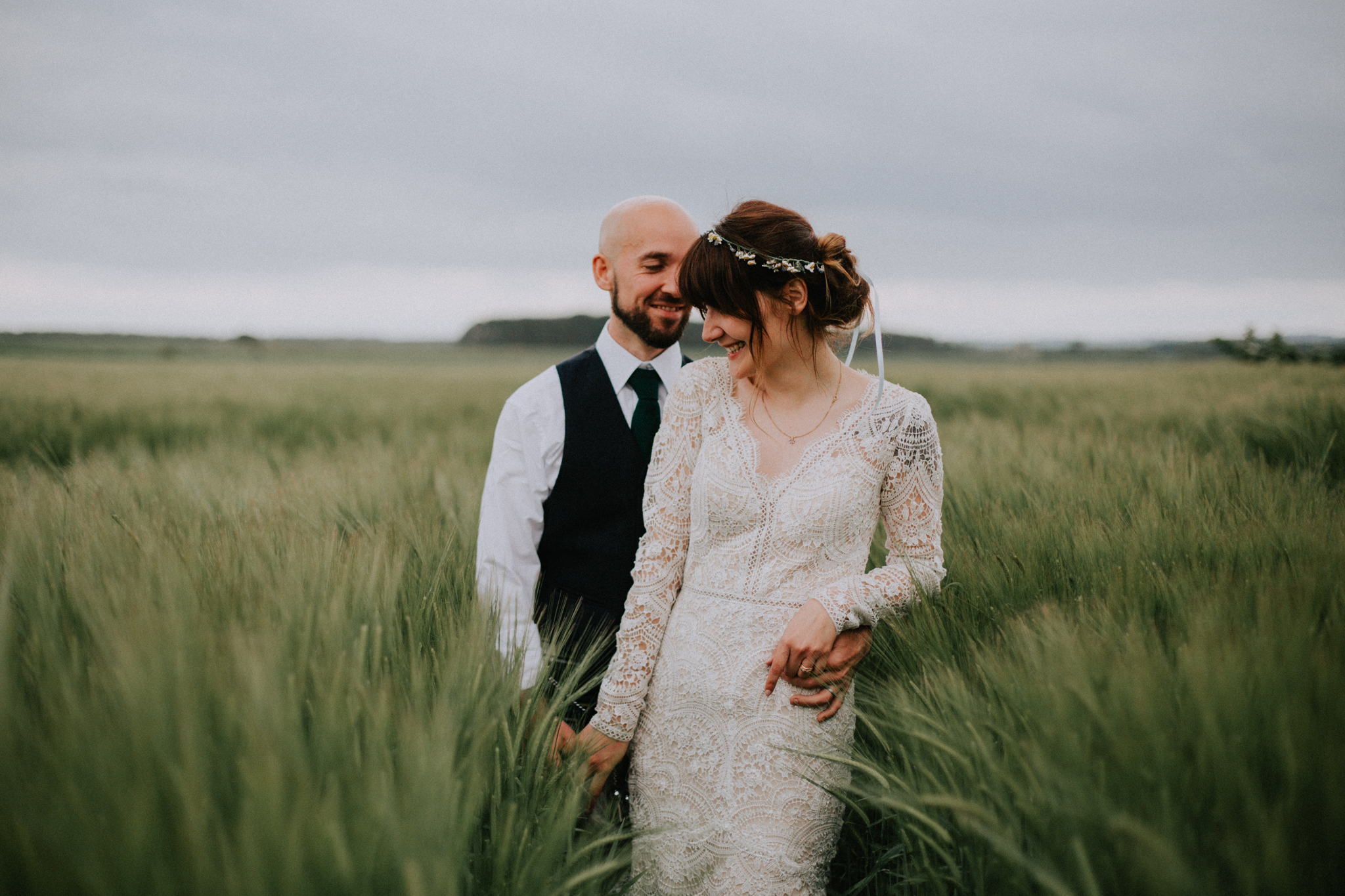 The couple shoot in the field at the Rhynd