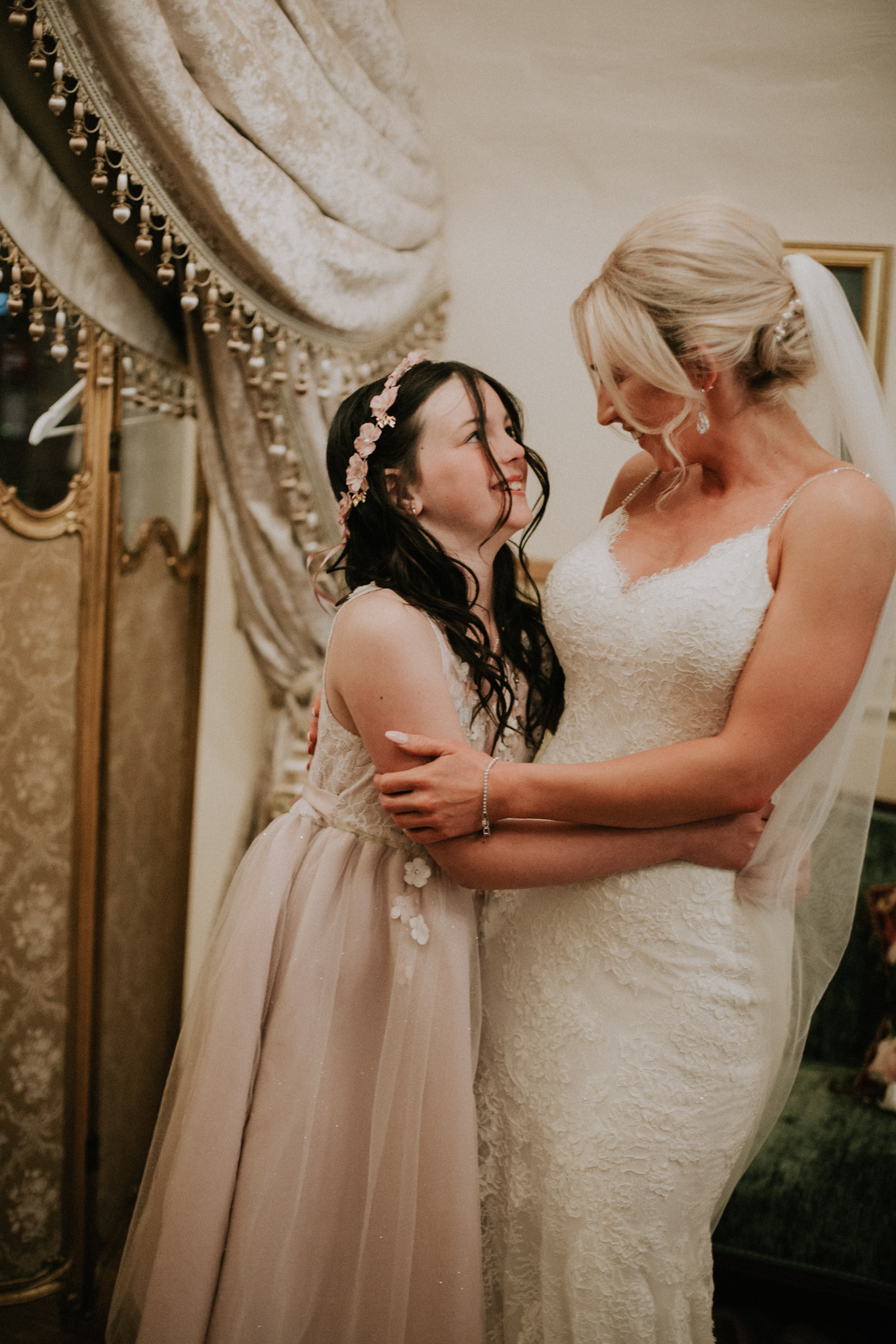 A special moment between the bride and junior bridesmaid