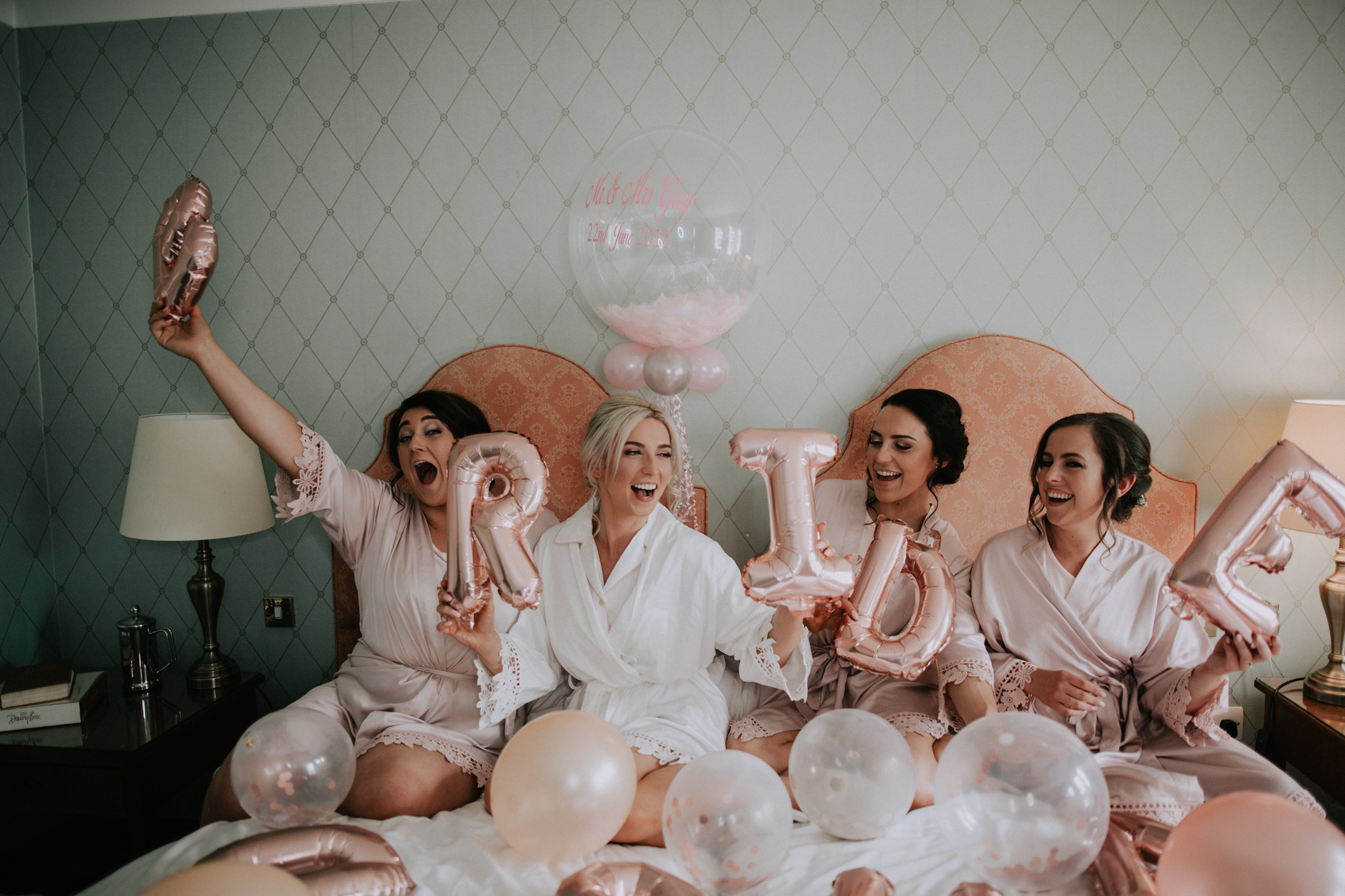 The bridal party is having a fun time at the bridal preparation