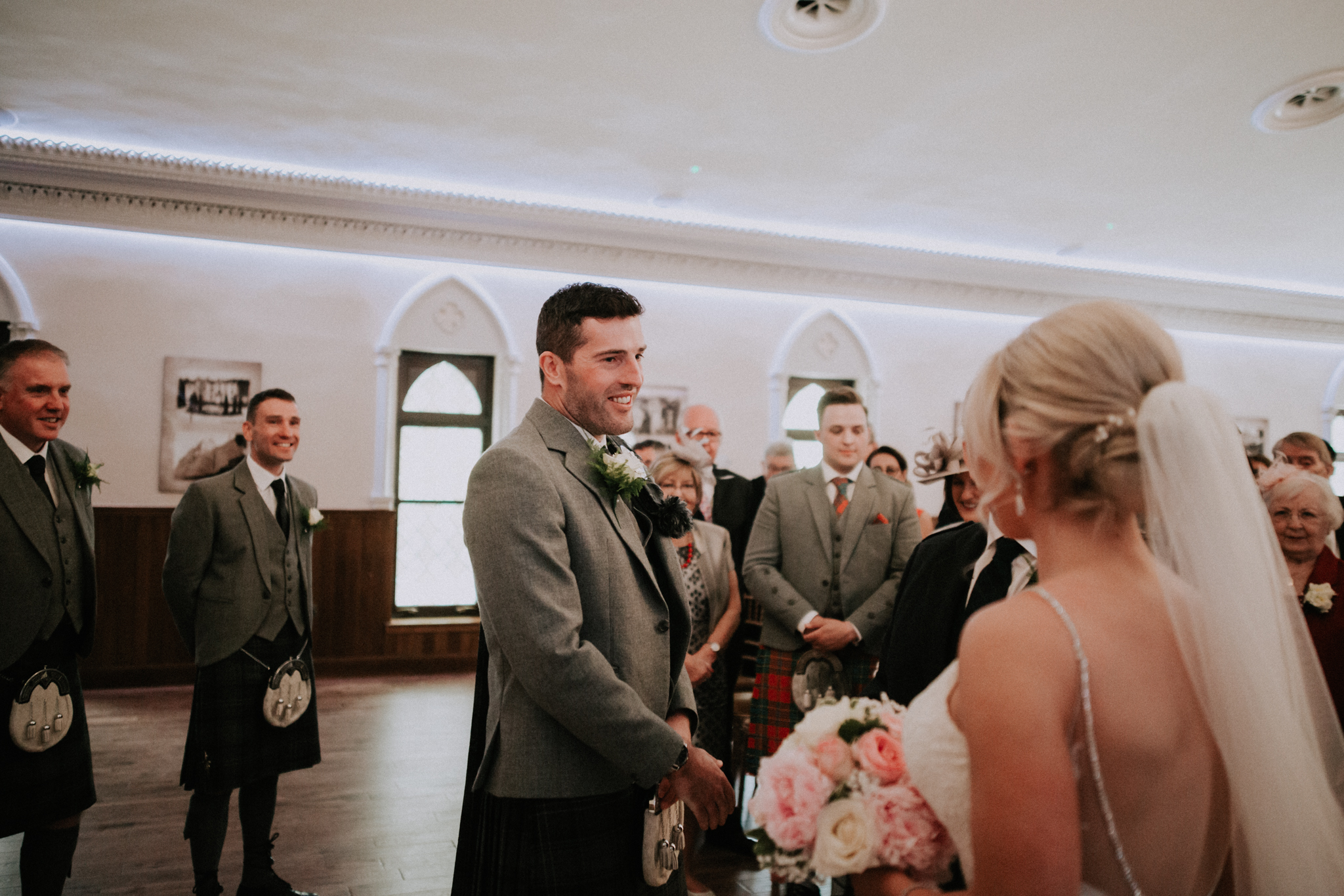 The groom is seeing the bride for the first time